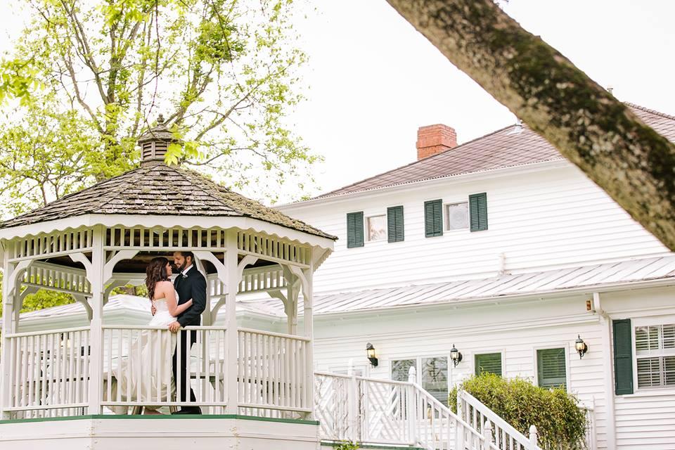 bride and groom at the gazebo at the grand magnolia house.jpg
