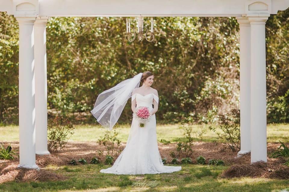 bride at the pergola at the grand magnolia house.jpg