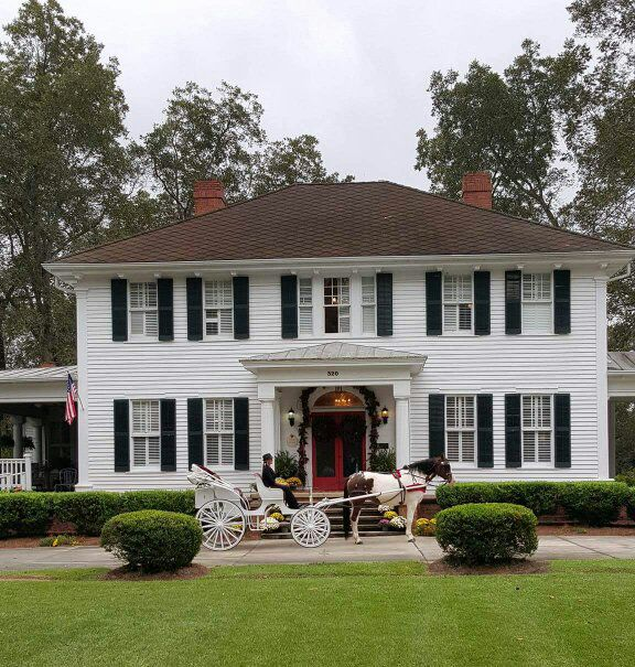 horse and carriage at the grand magnolia house.jpg