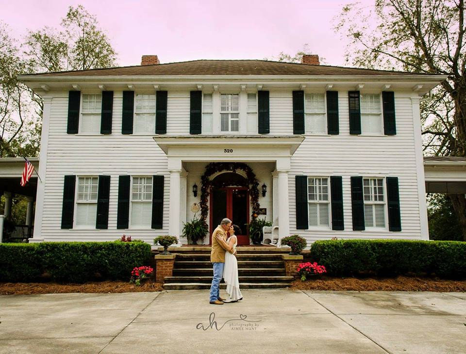 kiss your bride mr moore at the grand magnolia house.jpg