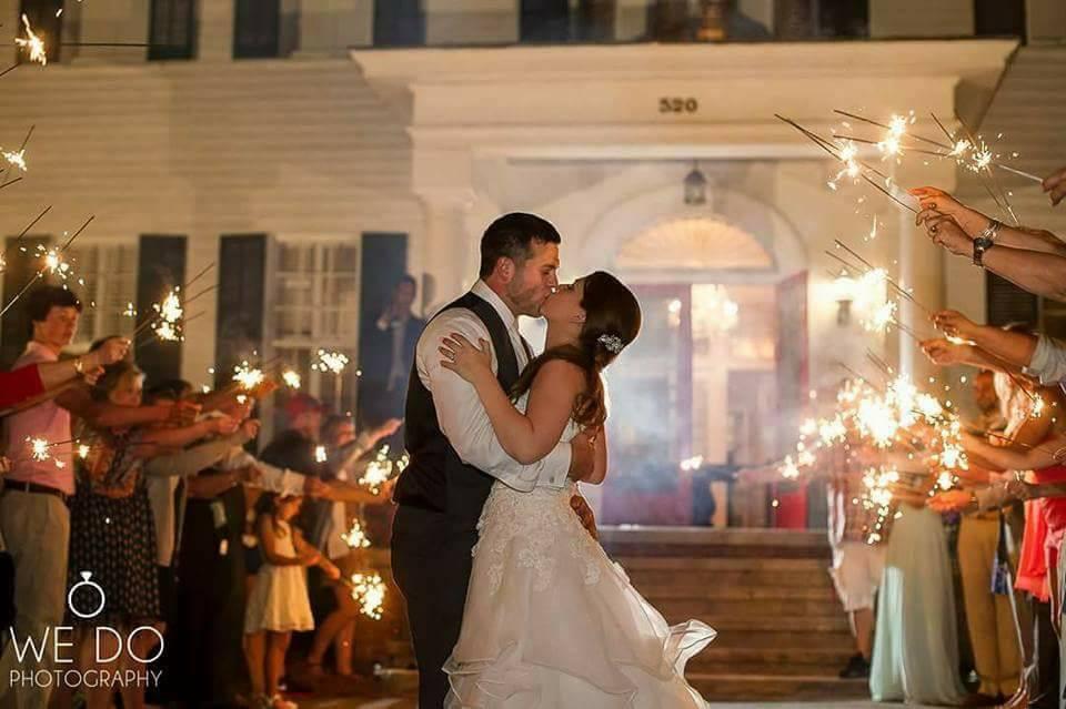 sparkler kiss at the grand magnolia house.jpg