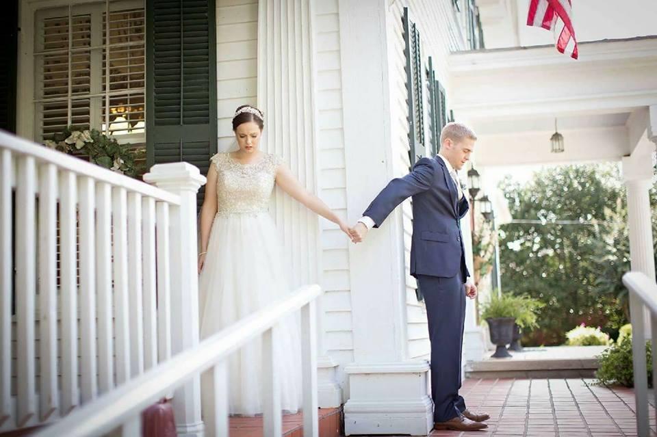 wedding prayer at the grand magnolia house.jpg