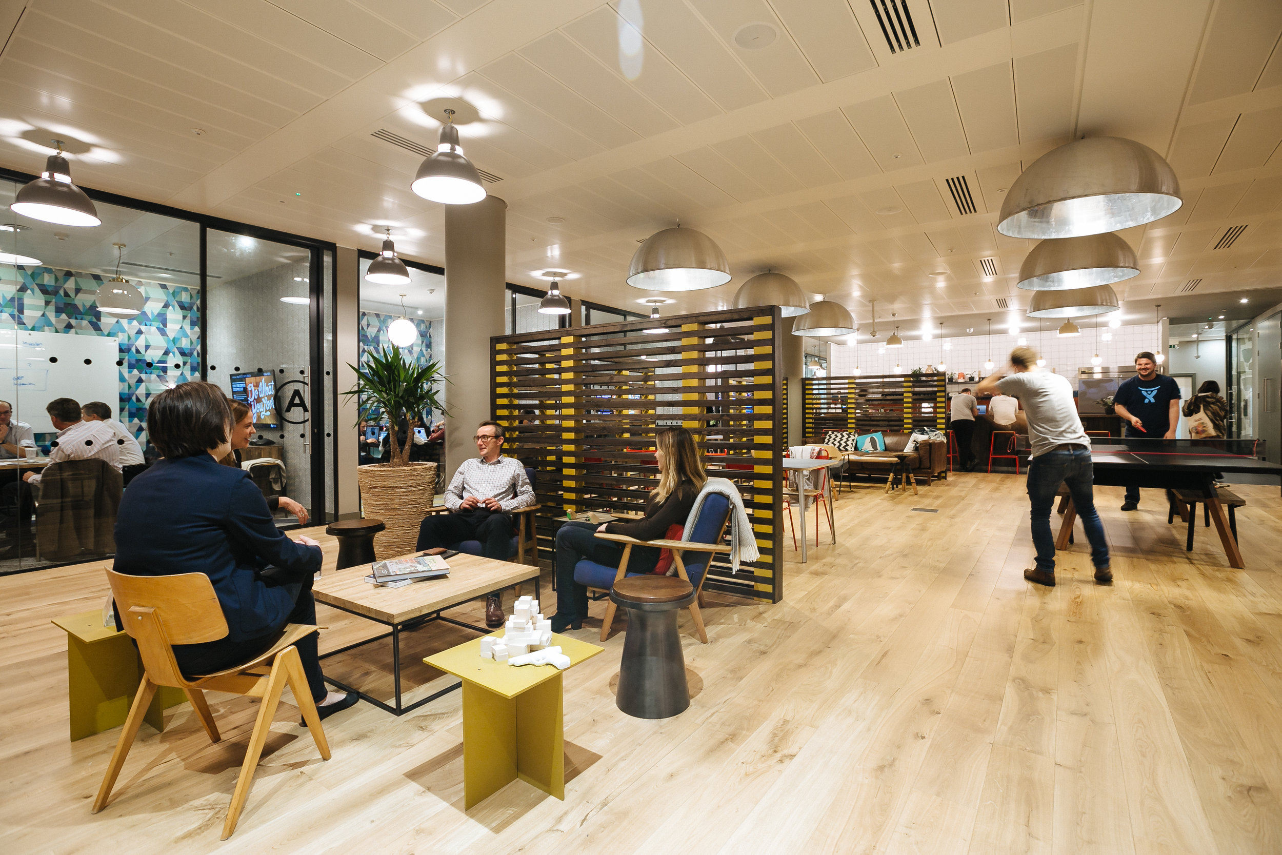 A WeWork office, with open meeting space and… ping pong.