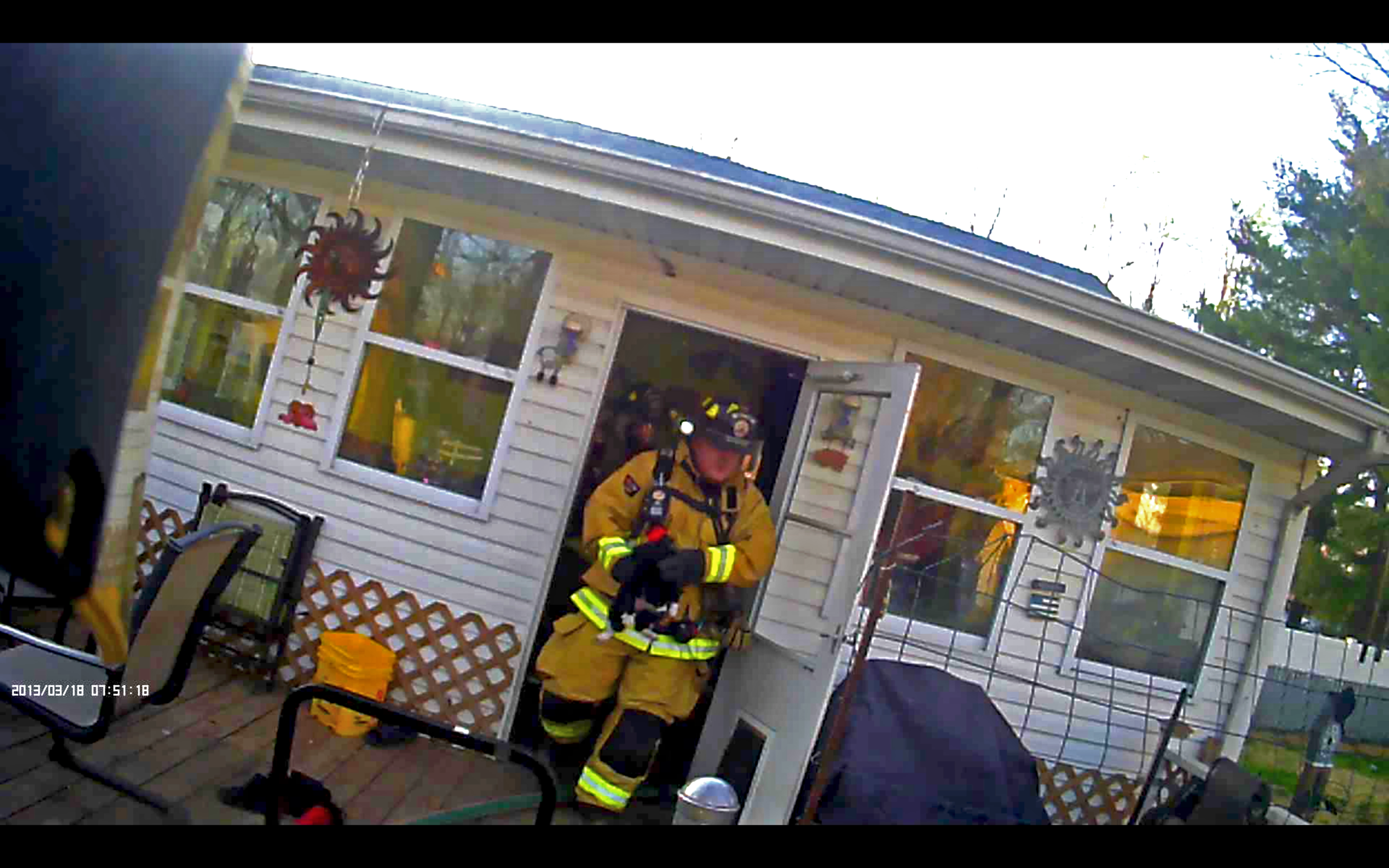 On 3 April 2016, ESFD responded to a report of a structure fire. Pictured is Firefighter Stock rescuing a pet from the residence. Firefighters were able to extinguish the fire in its room of origin, saving the home from further damage.