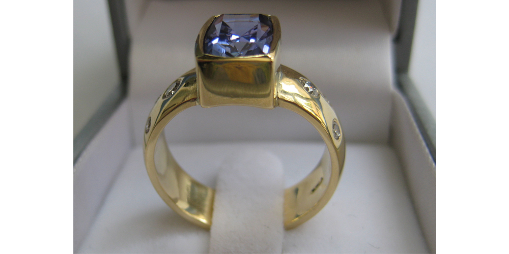 Tanzanite and Diamond Ring in 18ct Gold