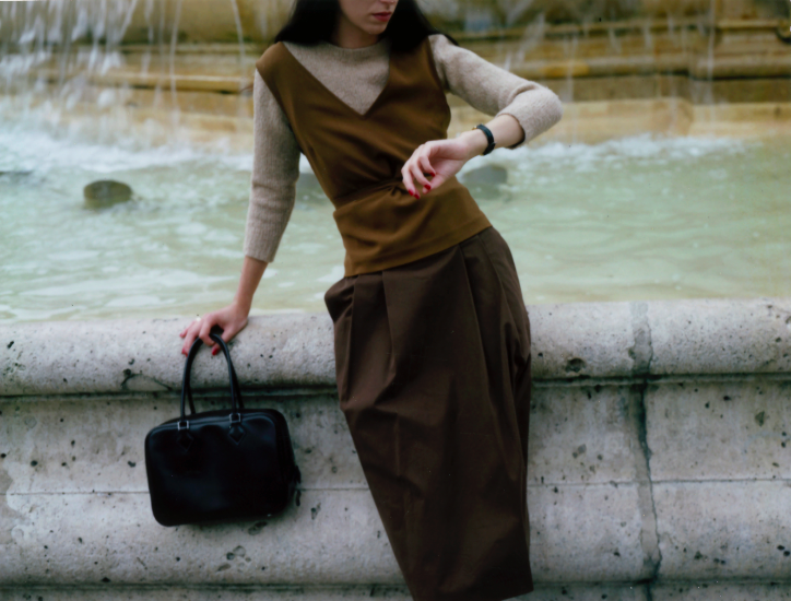 "A.P.C wool sweater, Amin Kader crepe top, Margaret Howell skirt, ""Plume"" Hermes bag in brown swift calfskin, ""Tank Solo"" Cartier watch."