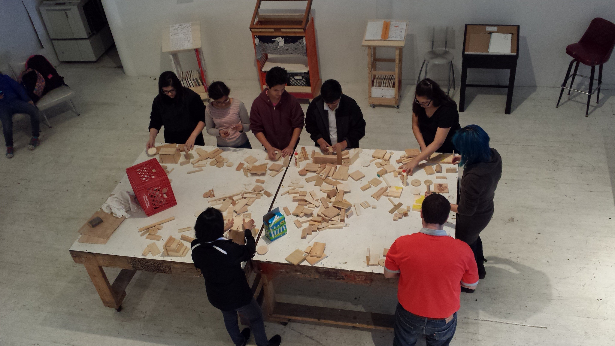 Walsh Elementary students taking a wood sculpture workshop by CAD resident artist Jorge Hinojosa.