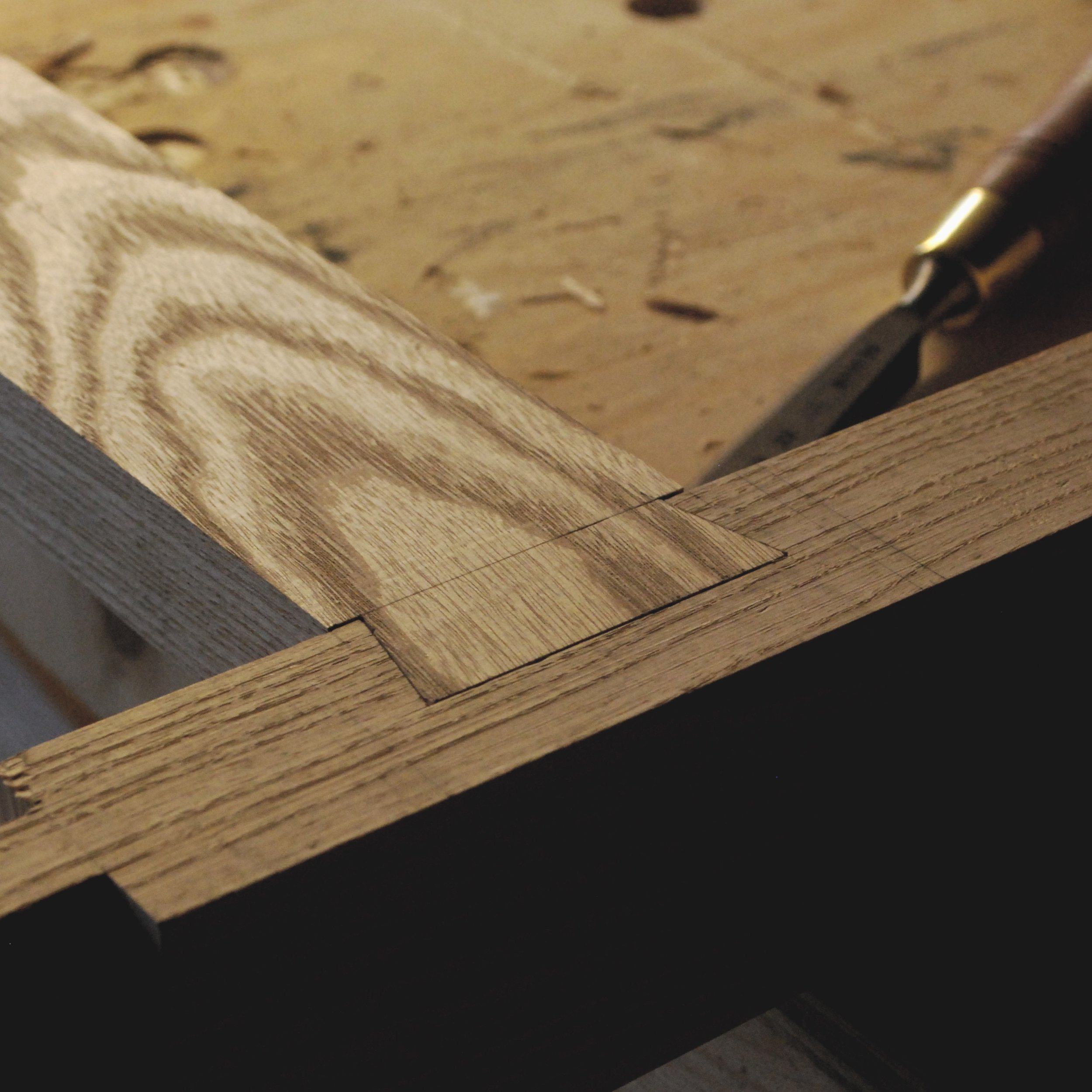 Large dovetail joint in a bespoke ash dining table