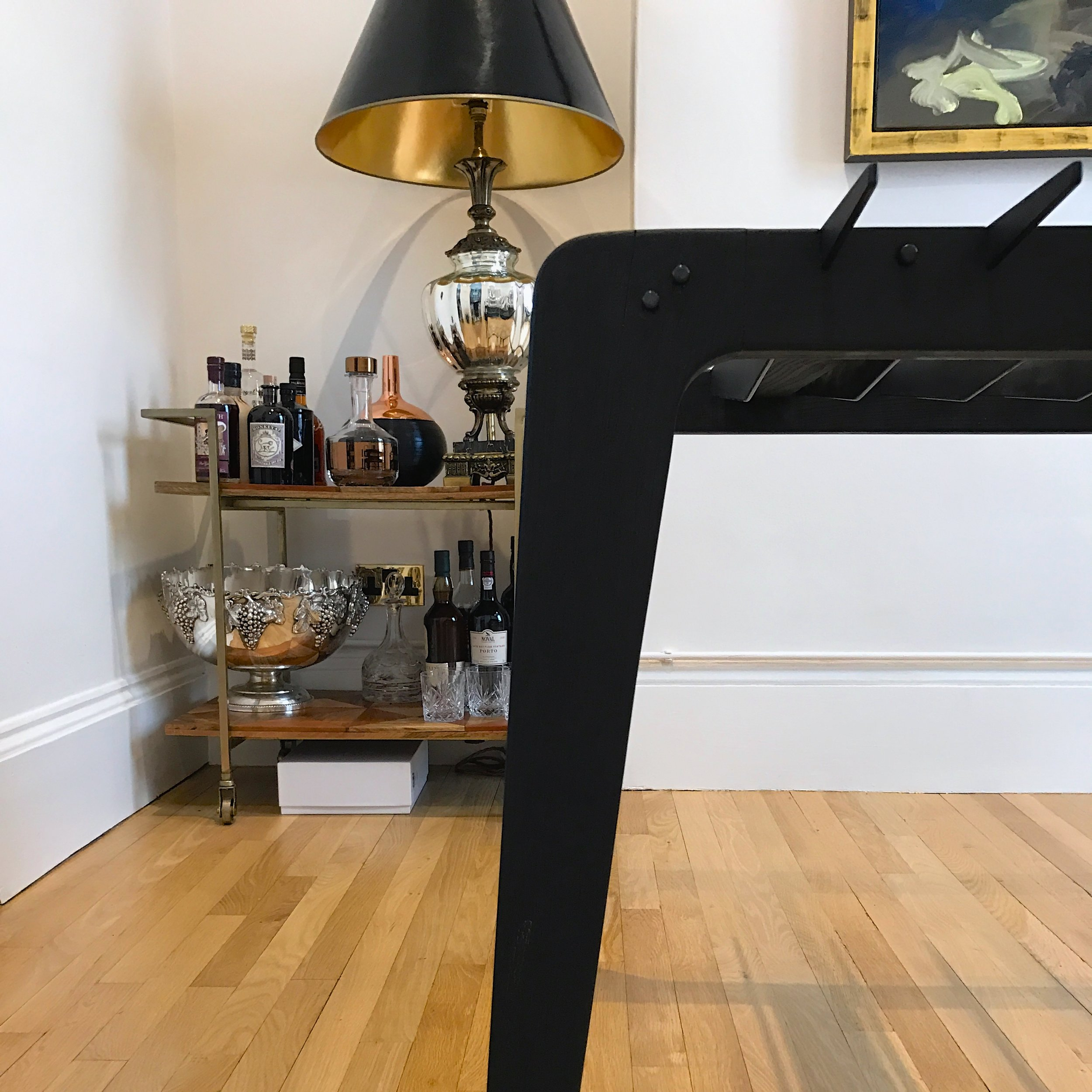 bespoke charred ash and blackened steel dining table detail