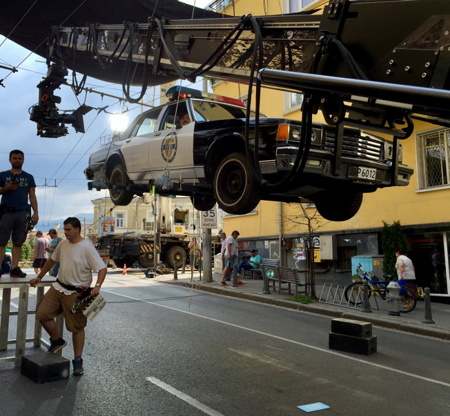 Sofia, Bulgaria- Suspended by crane for a commercial shoot!  Note my mustache peeking through the passenger window.