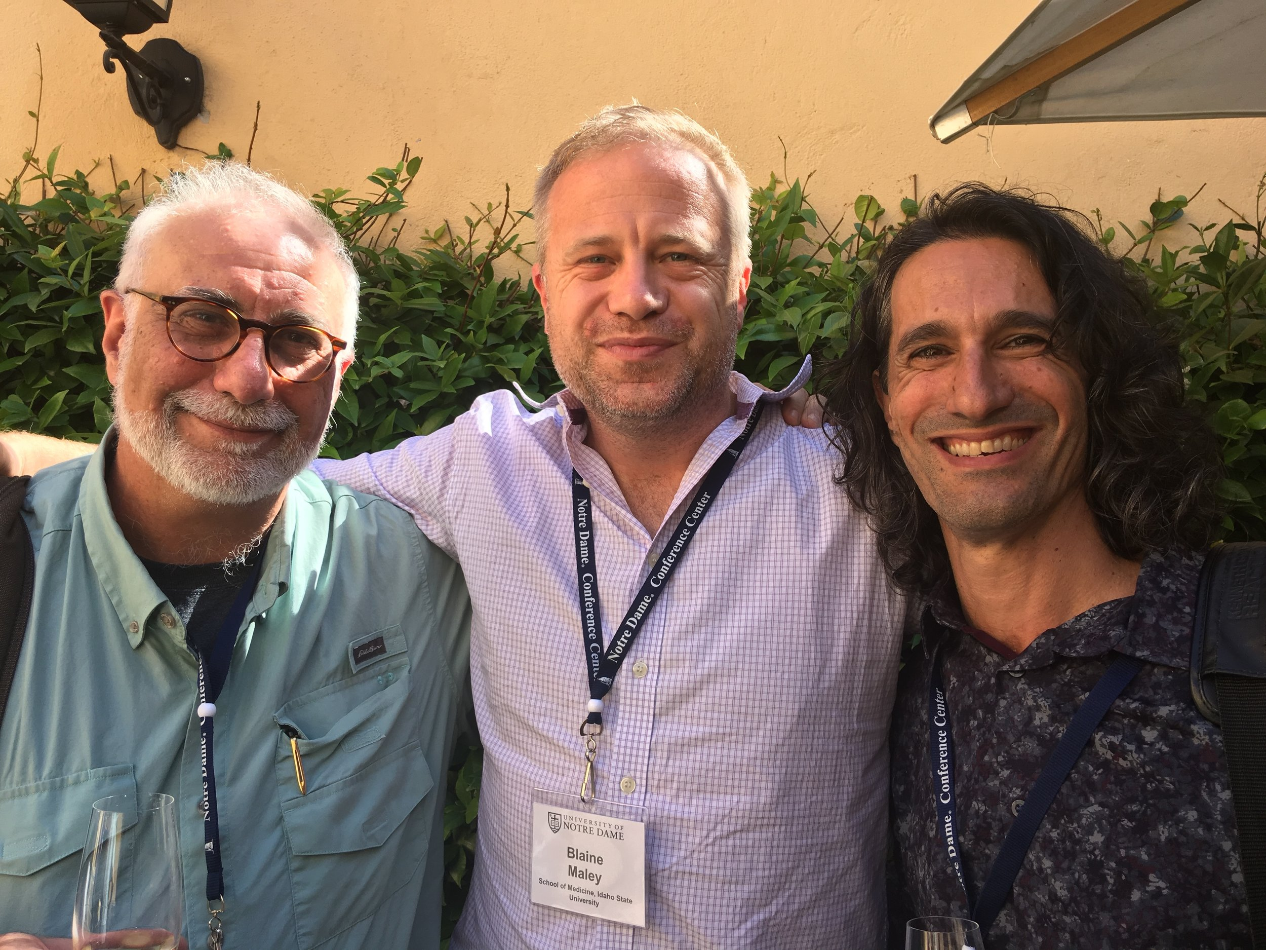 Dr. Blaine Maley (center) alongside his colleagues at the conference in Rome, Italy.