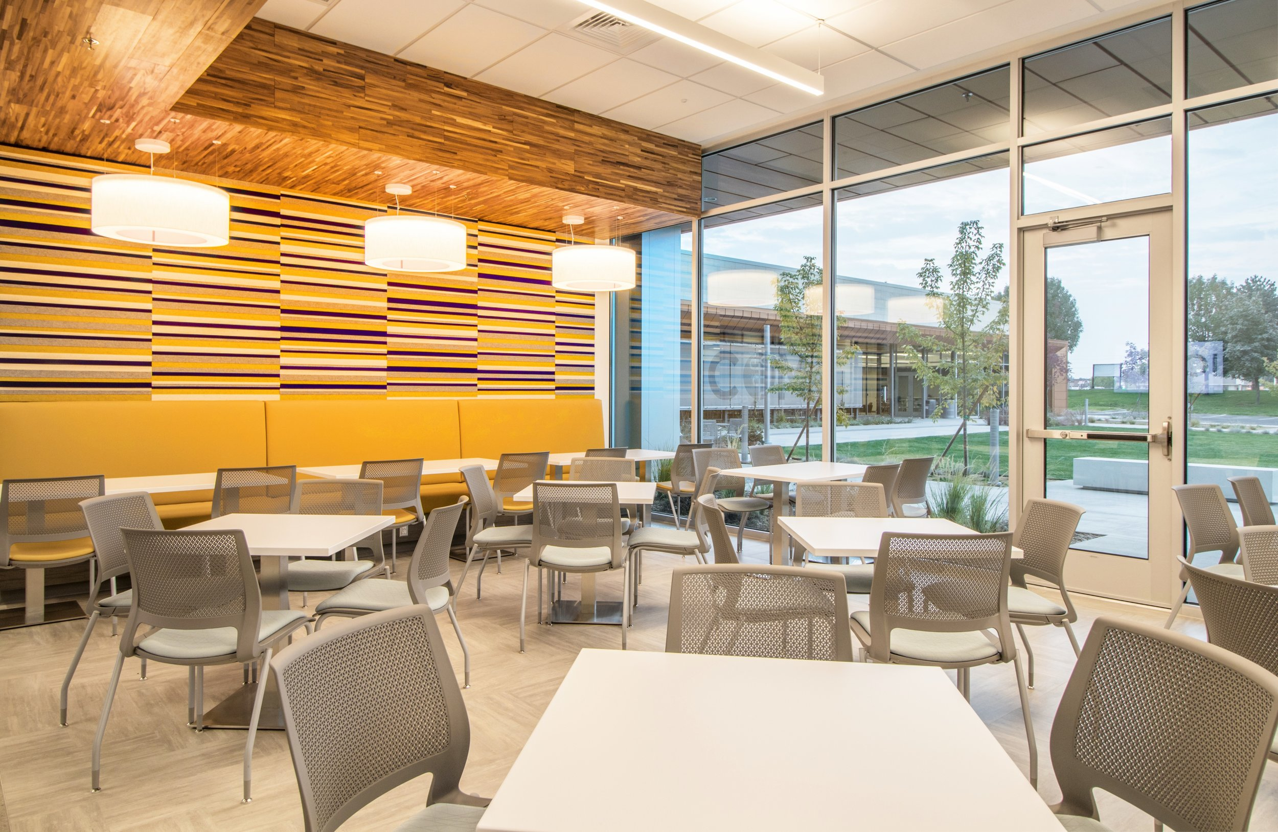 Student lounge 2  - 662 sq ft space with bar top, high-top and soft seating. Lounge has microwaves, refrigerators, food vending and cabinets.