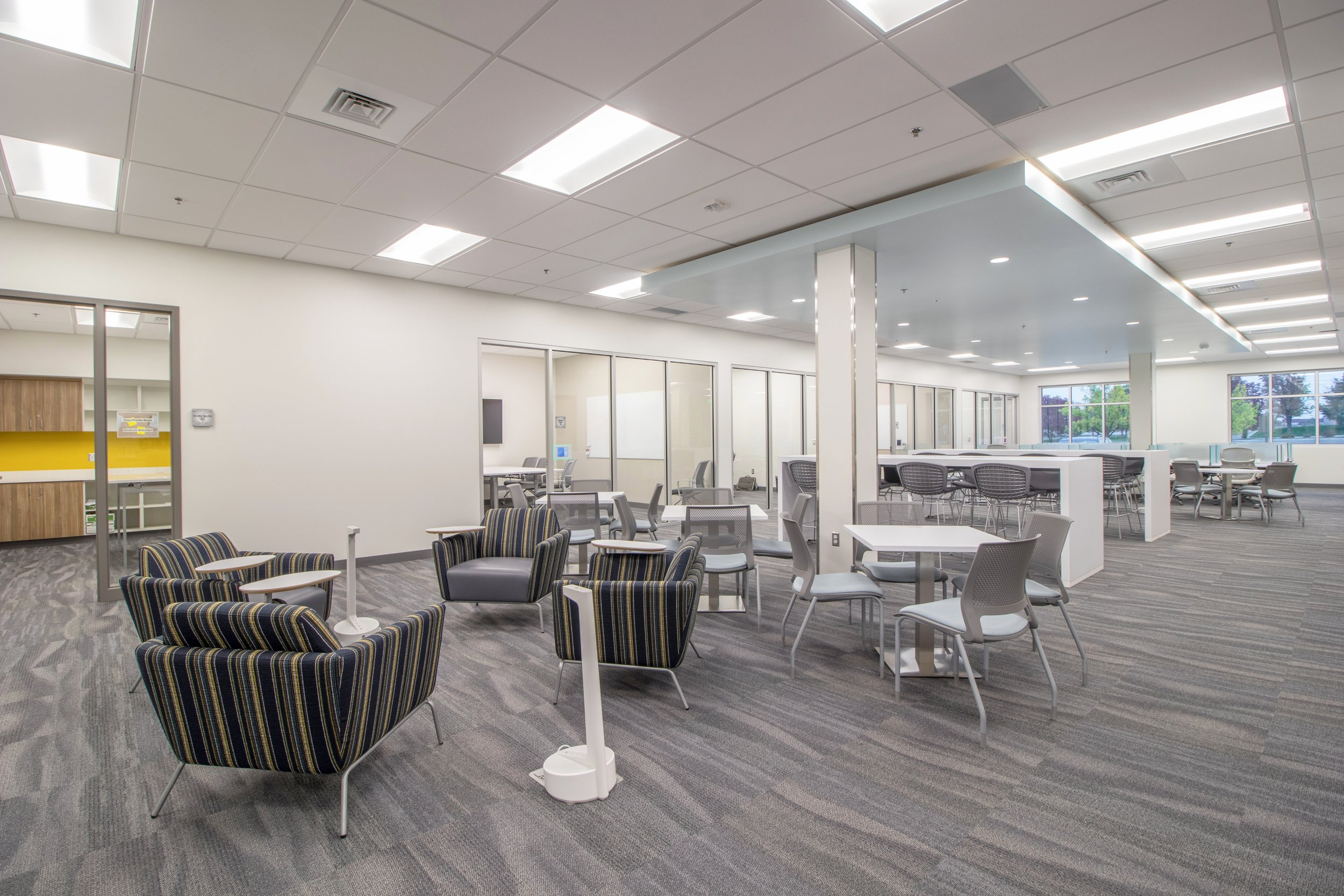 Library  - 2413 sq ft with a mix of high-top seating, study carrels, small table and soft seating for 76 students. In addition, there are 4 group study rooms each with seating for 9 students making a total for the library of 122.