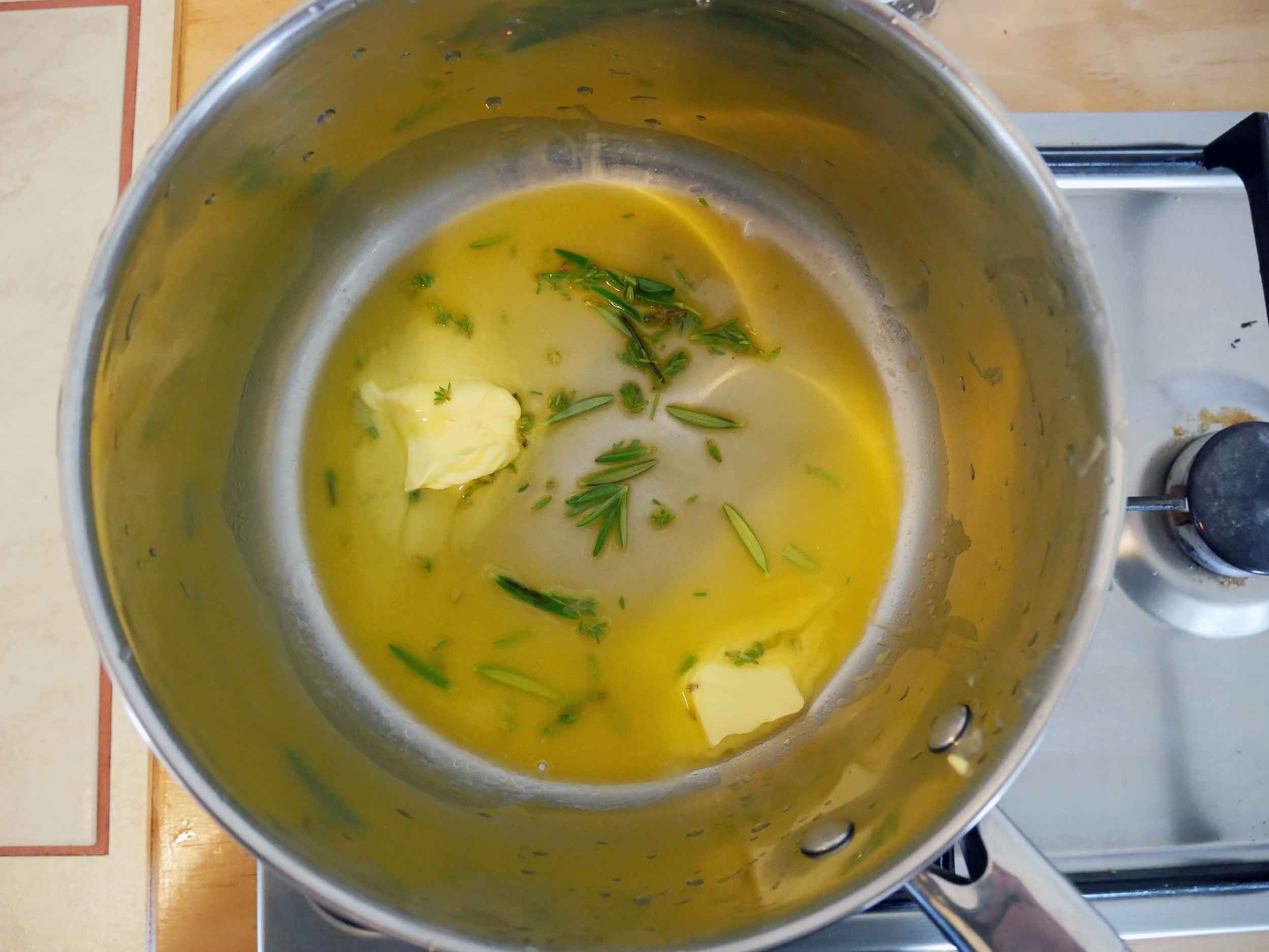 Melt butter then add fresh herbs for flavor (2-3mins).