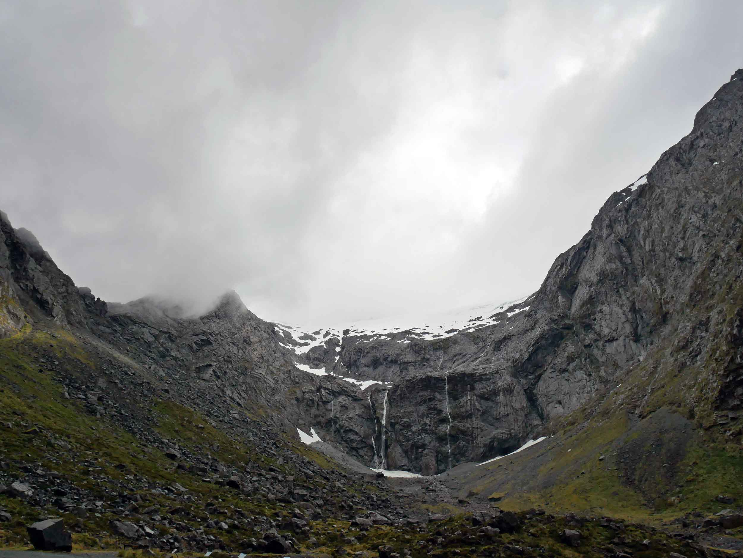 The icy view as we waited to pass through the 1.2 km long Homer Tunnel with unlined granite walls and 1:10 decent into the Cleddau Valley and Milford Sound (Jan 9).