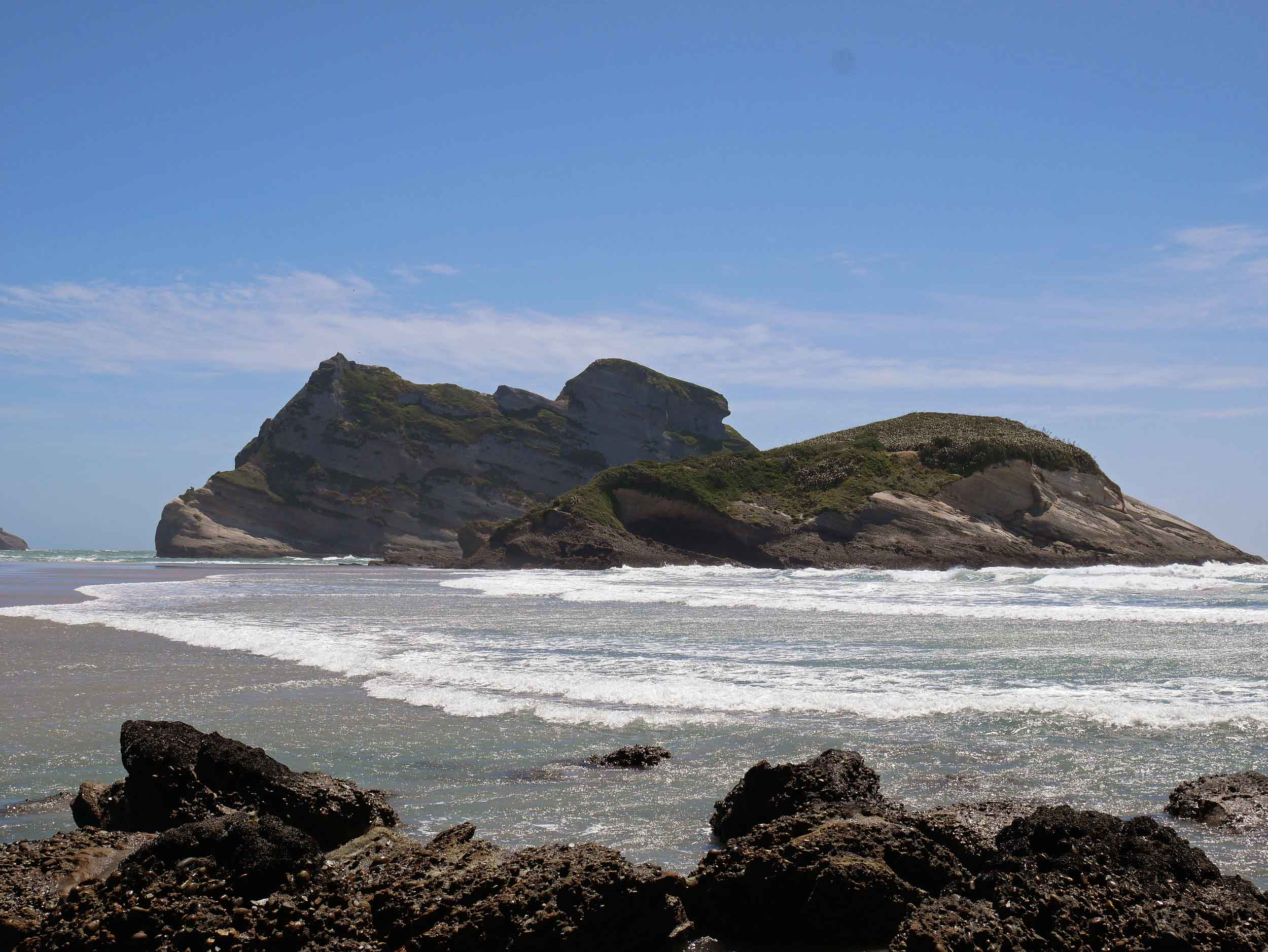 Cliffs border Wharariki Beach with the famous Archway Islands dotting the waters and on this particular day, massive wind gusts changing the landscape before our very eyes (Jan 13).