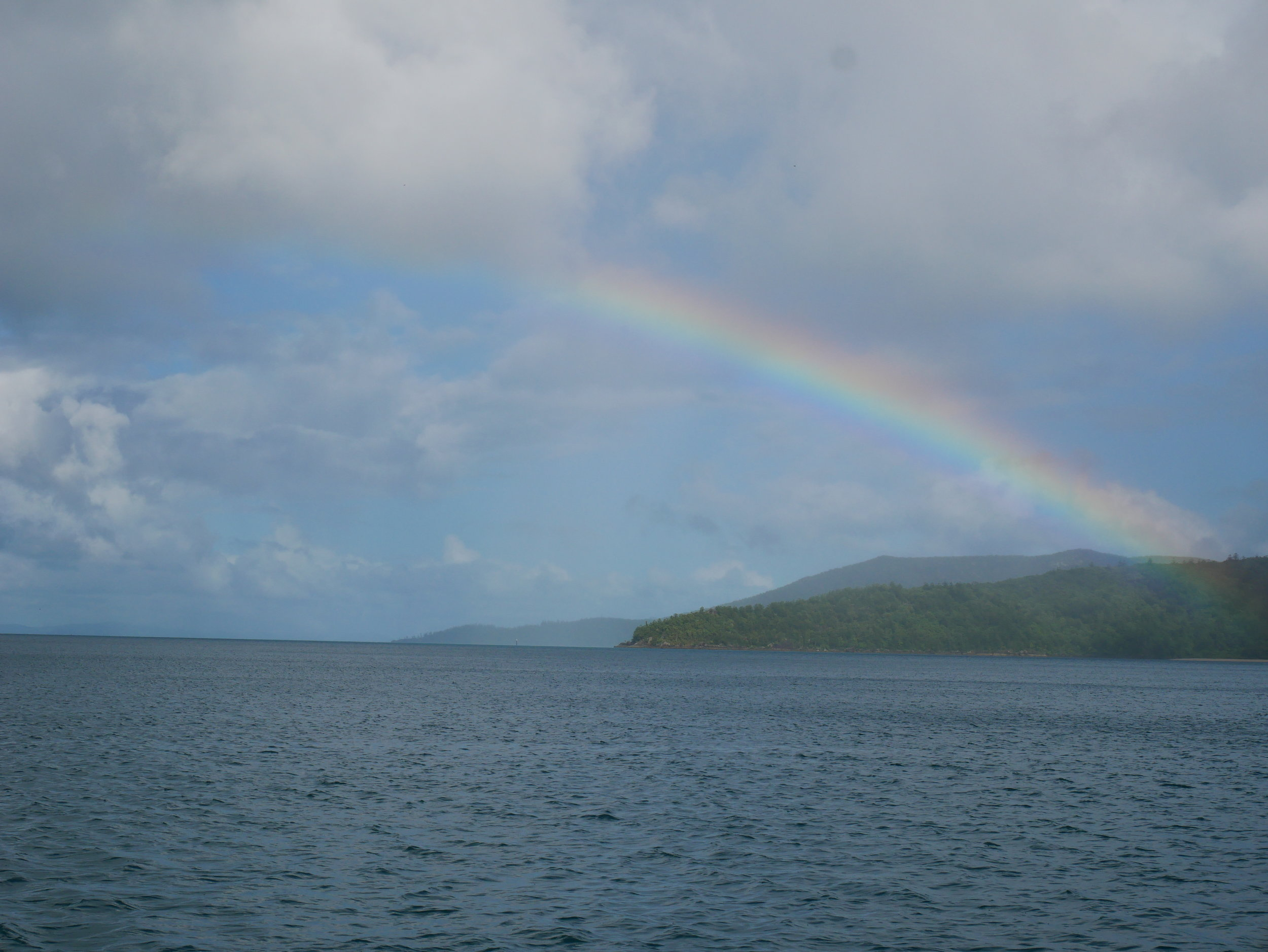 After some nighttime showers, the sun reappeared in the morning with this vibrant rainbow (Jan 25).