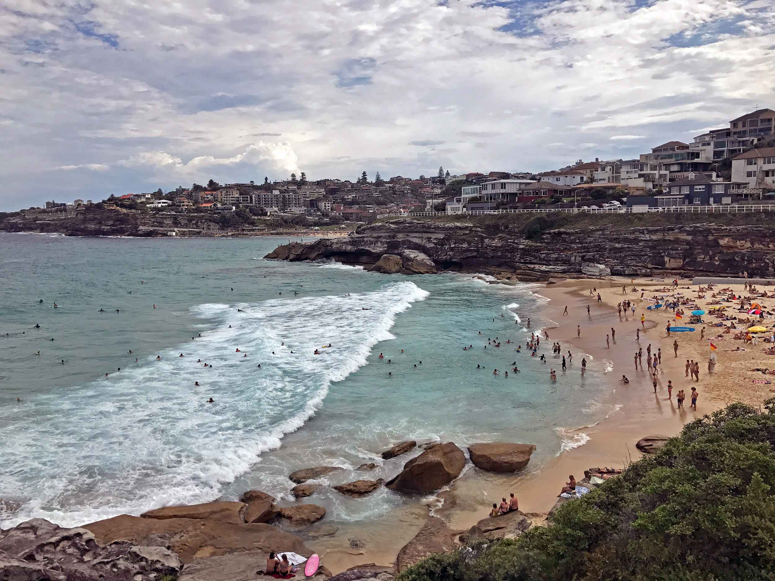 A heatwave swept Sydney, forcing most everyone to the beach, including small Tamarama (Feb 5).