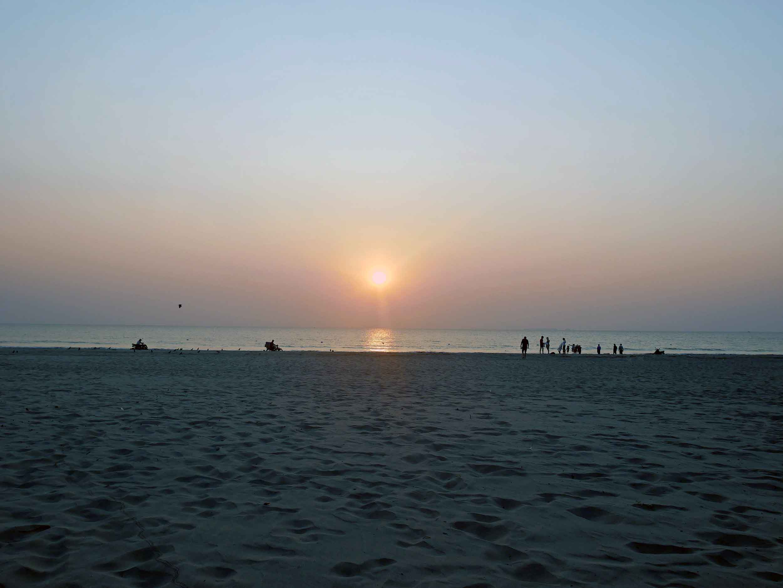 The wide beach of Ngwesaung becomes a sort of highway of activity around sunset.