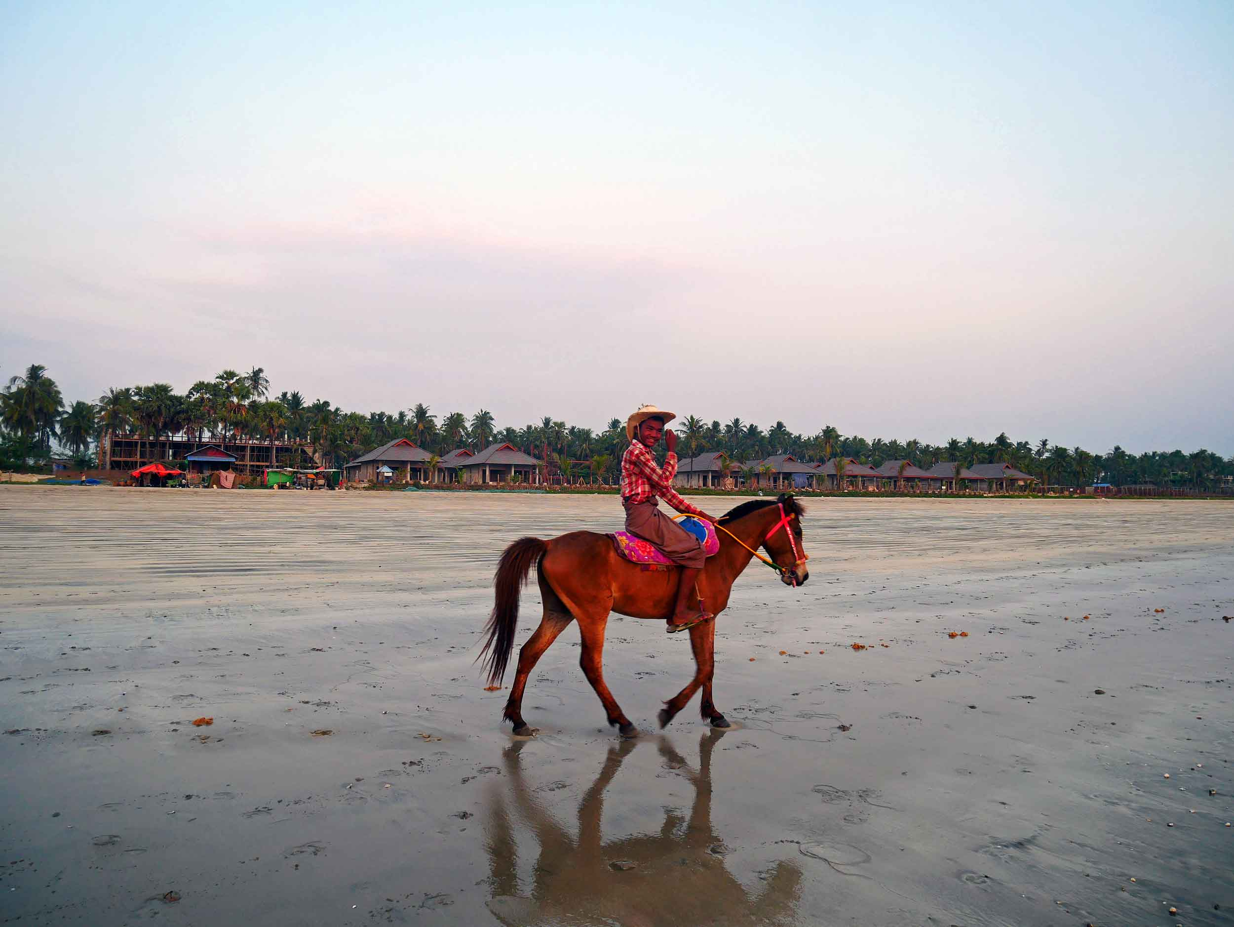 Young men on horseback gallop along the beach from point to point, often showing off for photos.