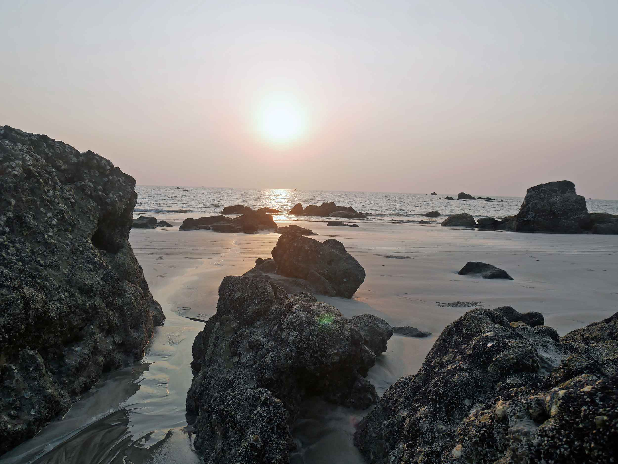 Long and wide Ngwesaung gently curves to reveal large rocks and finally, Lovers Island.
