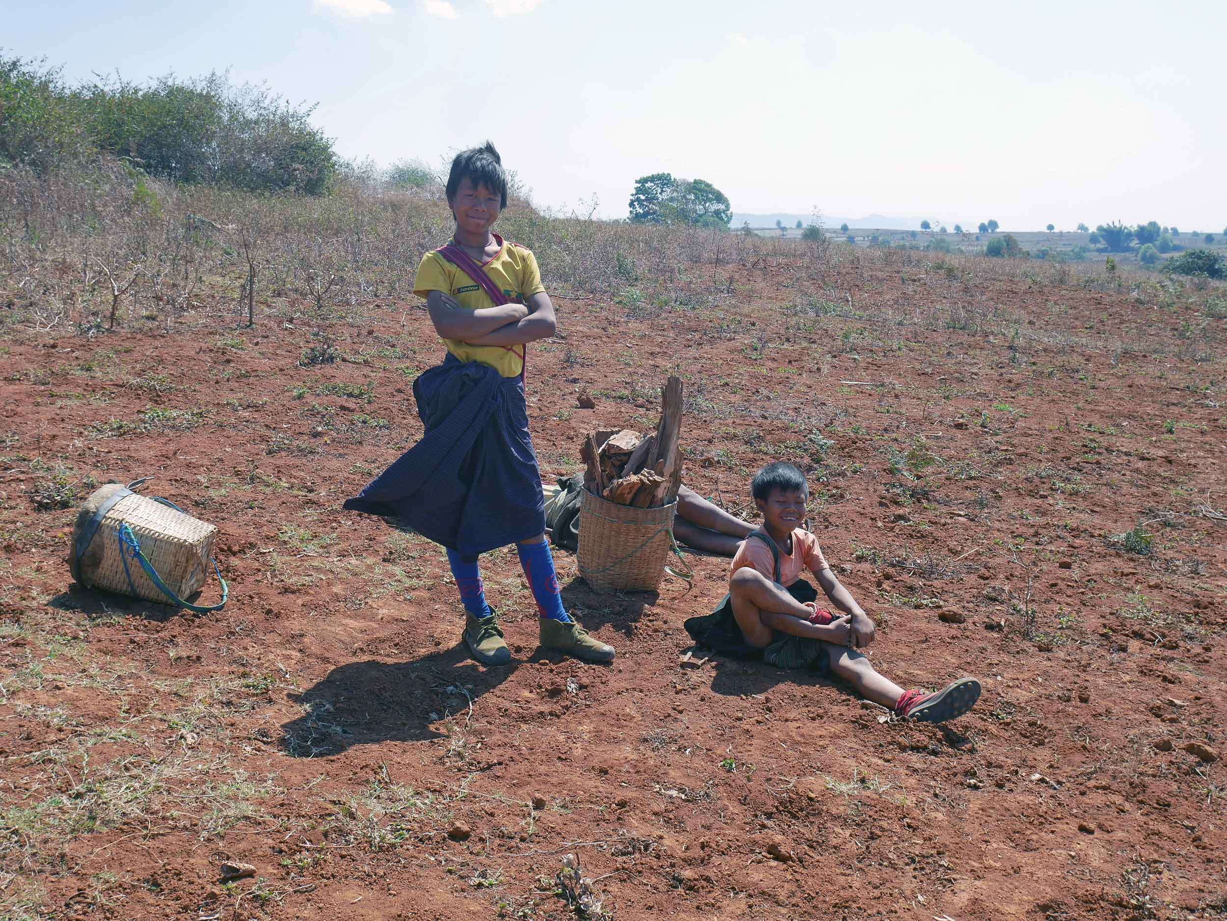Children take a rest with their father after chopping firewood (Feb 20).