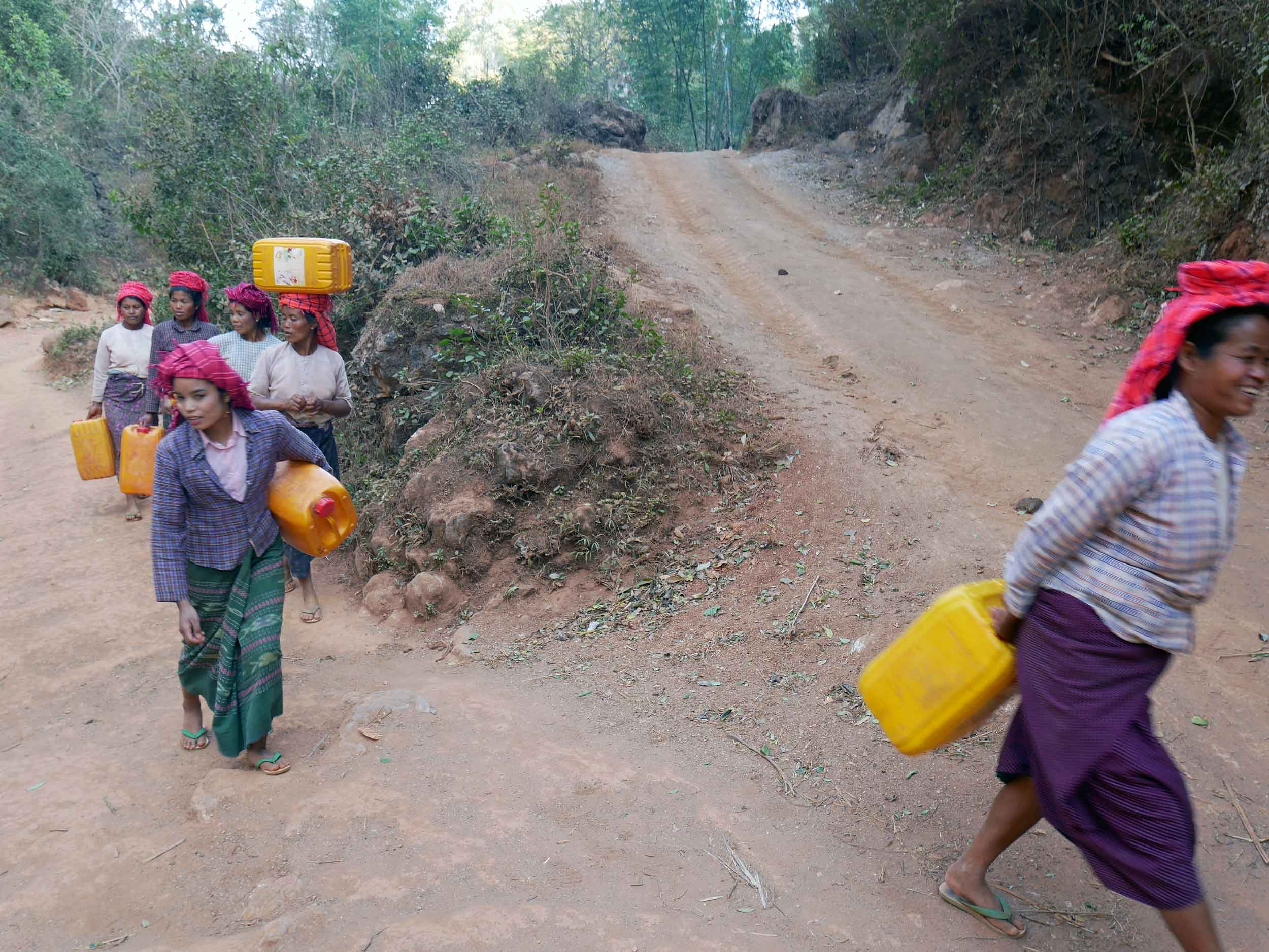 As we neared Pattu Pauk village, where we would spend the night, we passed local women walking to the well to collect water (Feb 20).