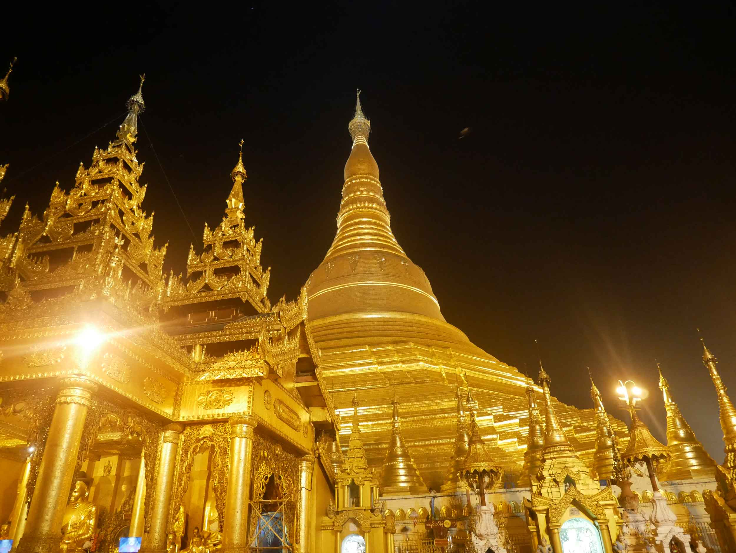 Shwedagon Pagoda in Yangon shines bright in the pre-dawn sky as locals and monks bring their offerings as early as 4am (Feb 9).