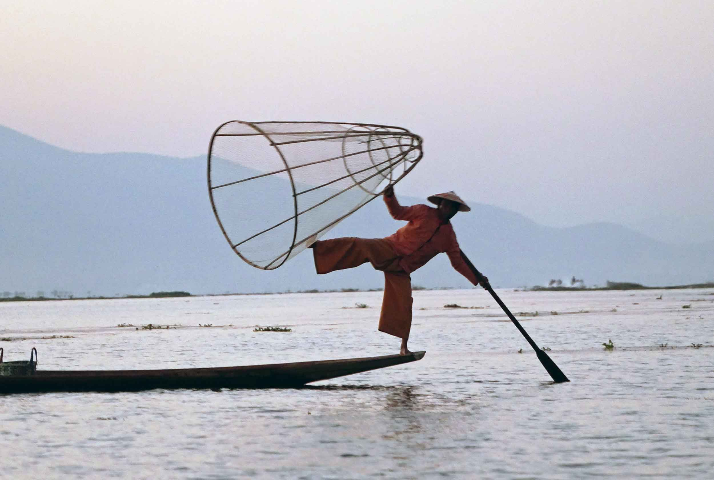 The balancing fishermen use one leg to paddle as they fish along Inle (Feb 22).
