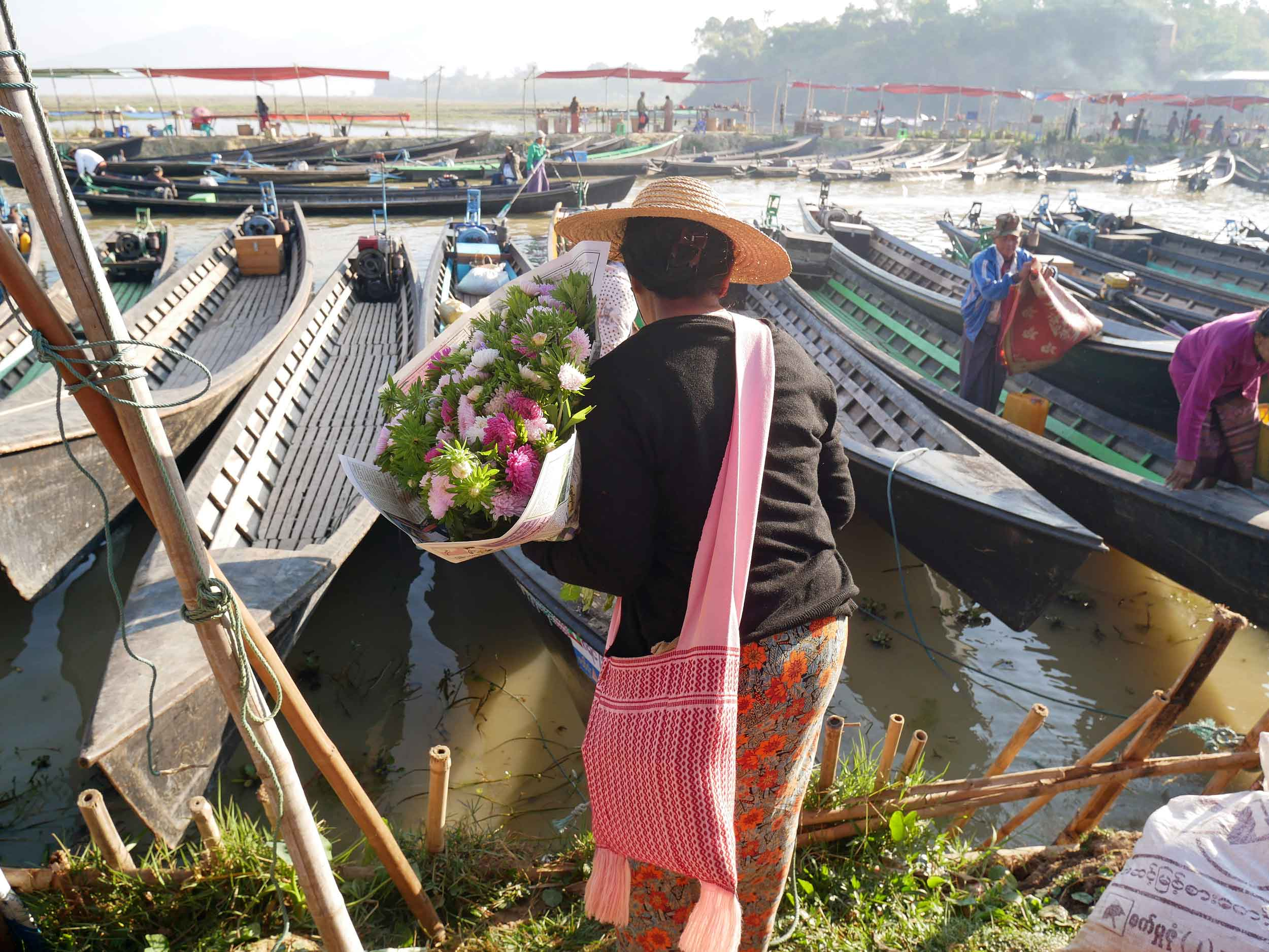 Shoppers wait for their boat taxi to make their way back home with their finds (Feb 22).