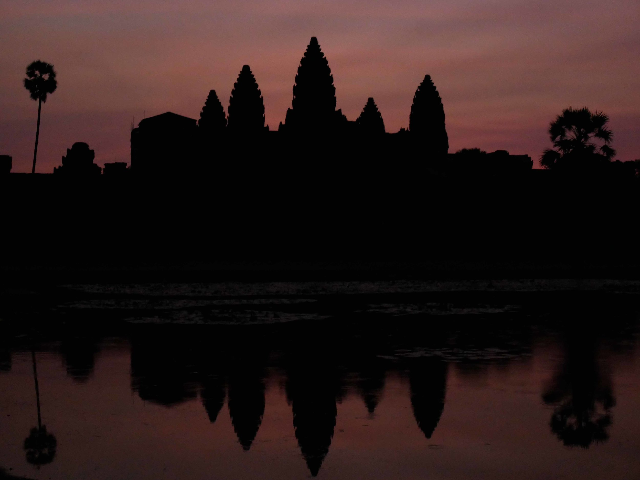 Sunrise at the famous Angkor Wat temple, built in the 11th century as a Hindu temple and later transformed to Buddhism (Feb 27).