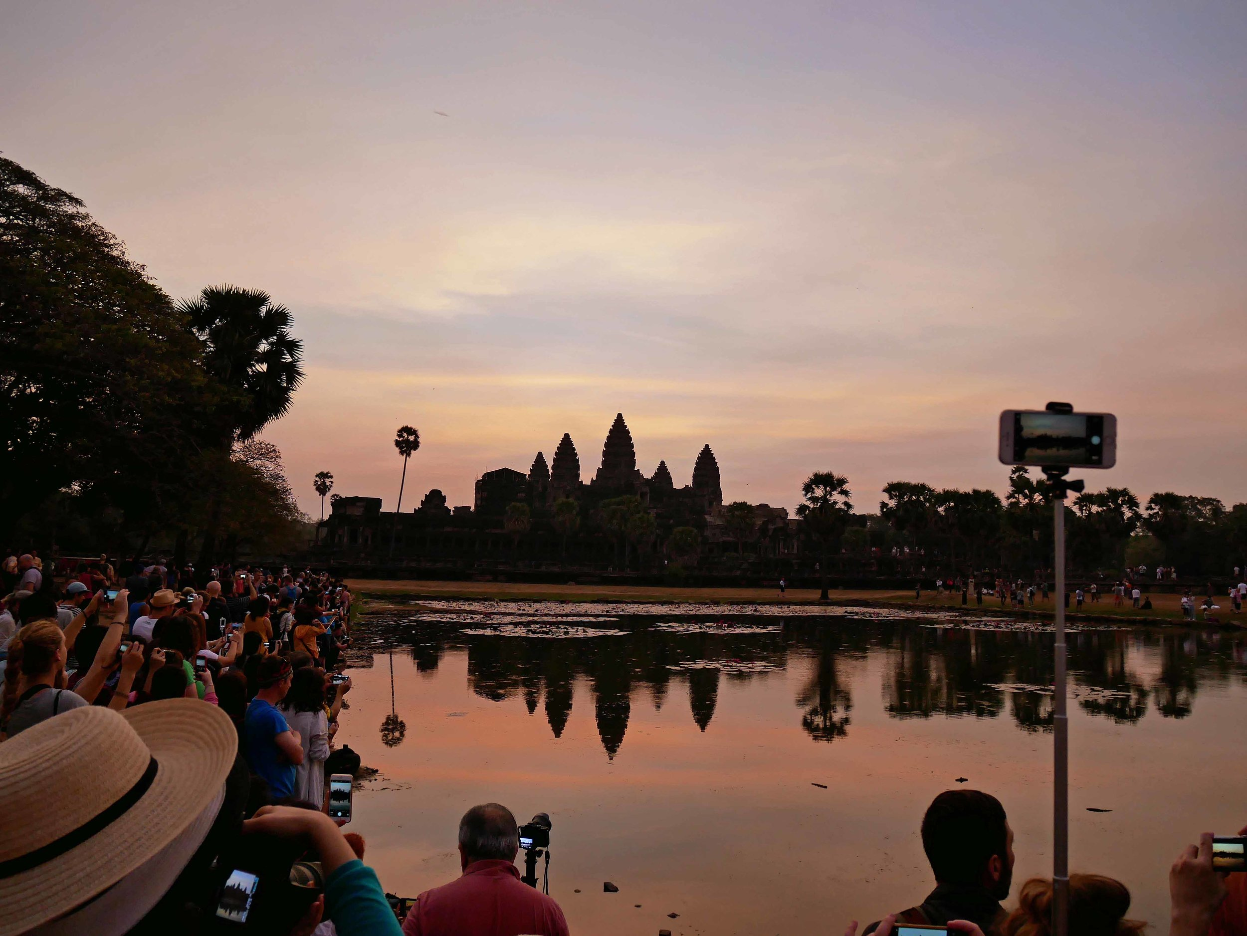Named #1 tourist destination by  Lonely Planet , hundreds of tourists joined us along the reflecting pools at Angkor (Feb 27).