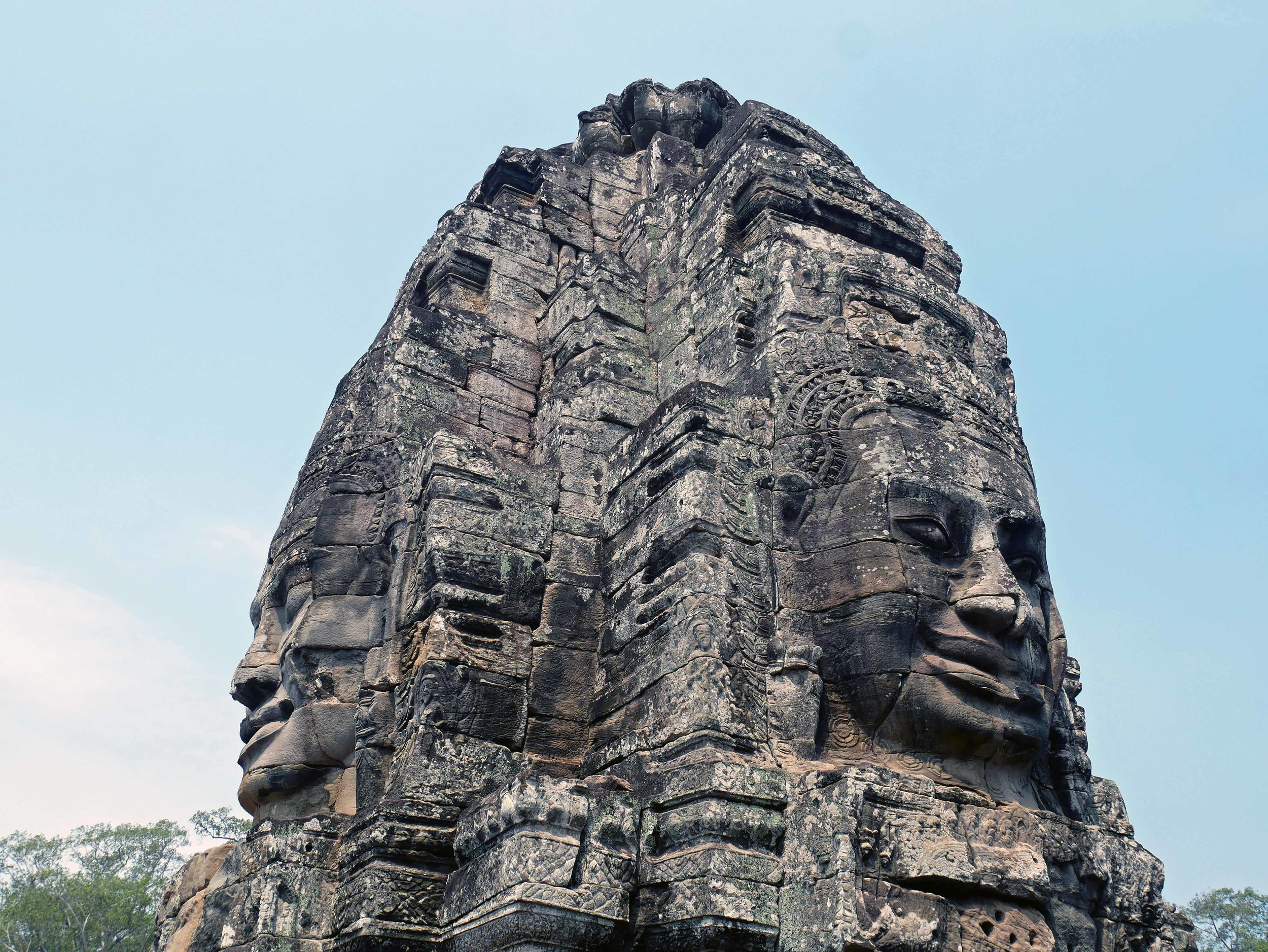 Bayon, our favorite temple in Angkor, contains oversized carvings of peaceful and smiling faces (Feb 27).