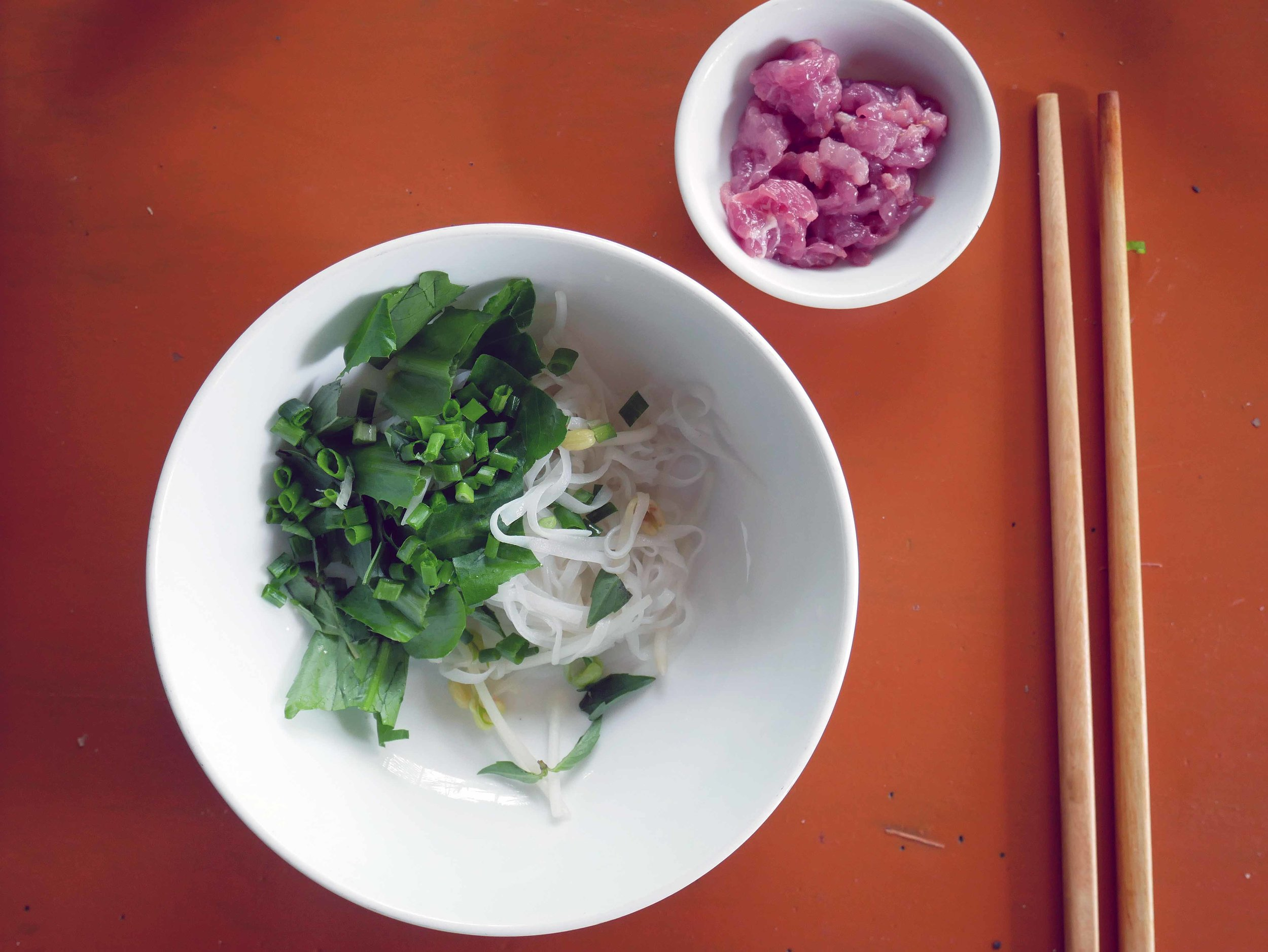 After briefly cooking the rice noodles for our Pho, we smothered them in bean sprouts, fresh mint and scallions, along with pickled shallot, in anticipation for the steaming beef broth.