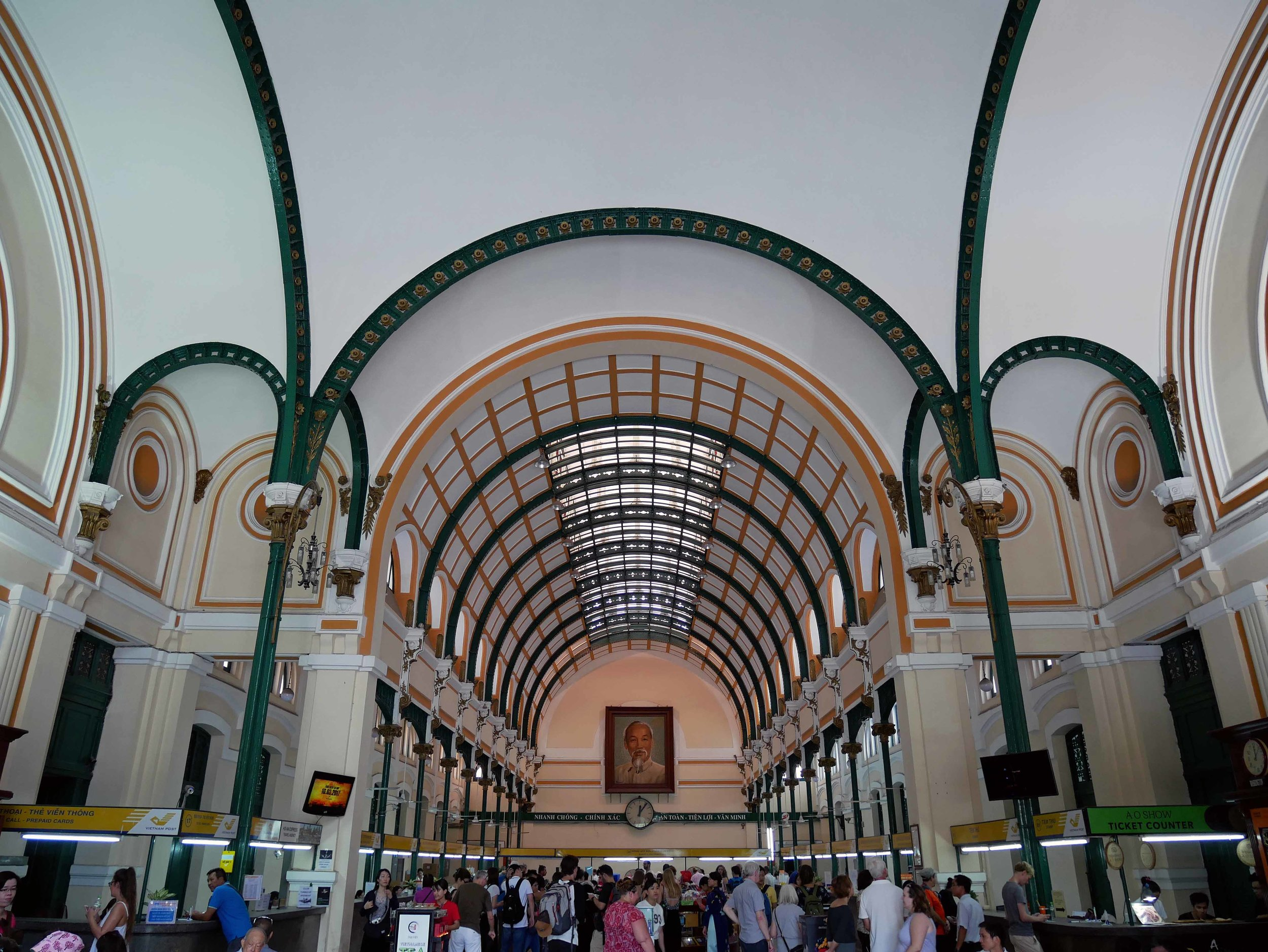The interior of the Post Office features high arched ceilings and a portrait of former revolutionary leader Ho Chi Minh.