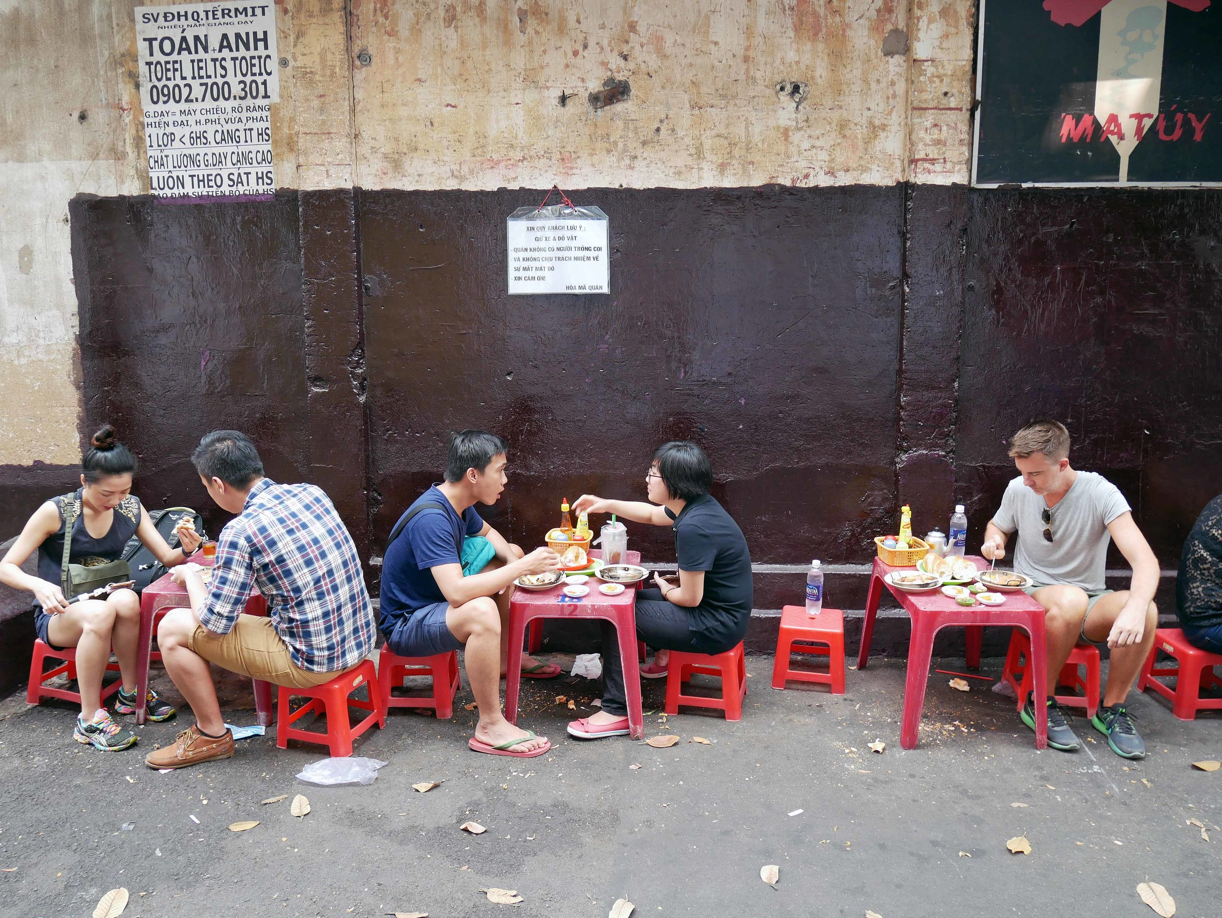 For breakfast the next morning, we found ourselves sitting in the alleyway at Banh Mi Hoa Ma for eggs and coffee (March 14).
