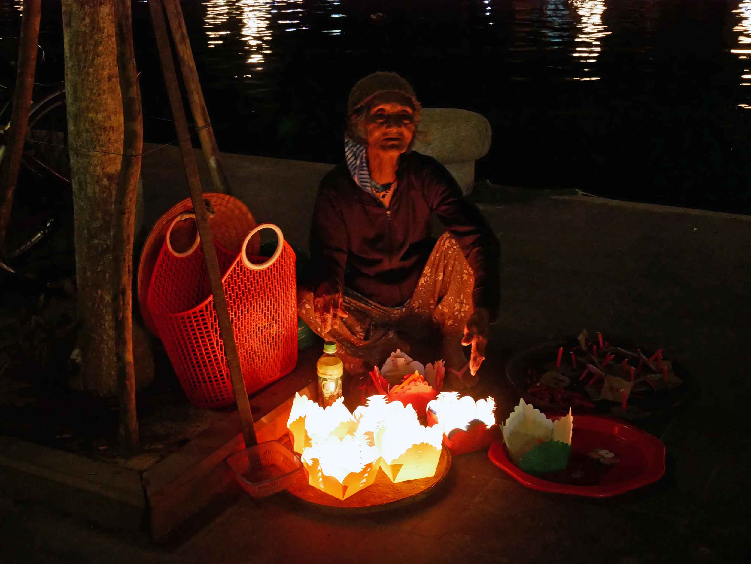 A beautiful candle seller along the banks of the Thu Bon River.
