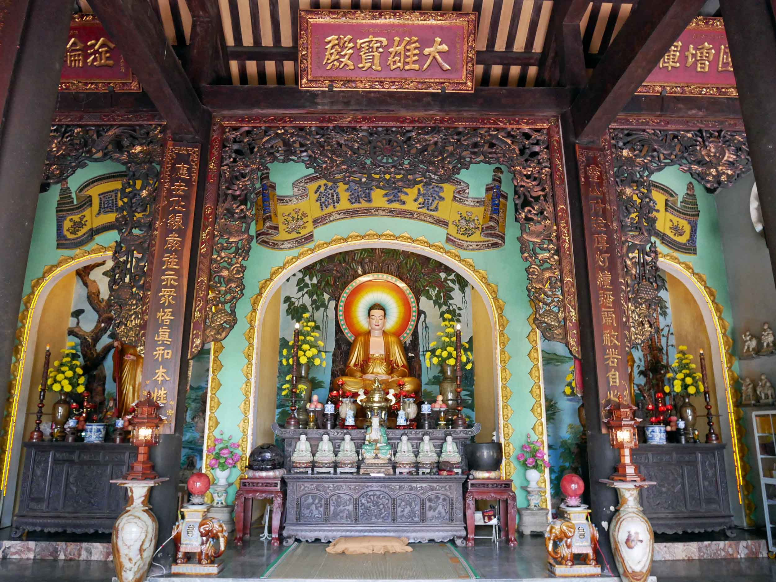 The bright, colorful interior of one of the pagodas dotting Marble Mountain.