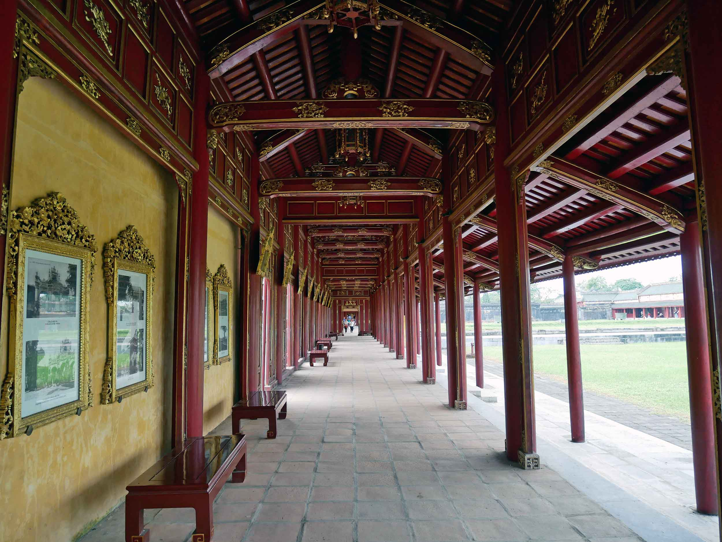 """One of several """"long corridors"""" within the Imperial City, now lined with history and photographs of the complex."""