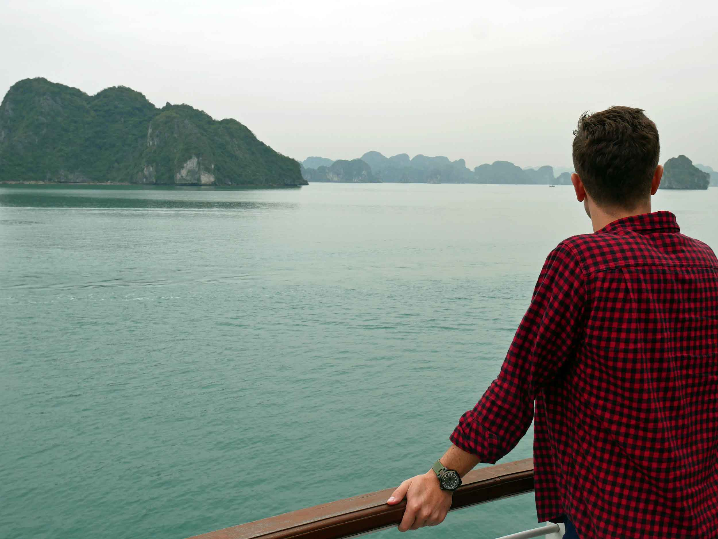 Martin taking in the beauty of these towering limestone islands from the deck of our cruise ship, The Cristina Diamond (Mar 27).
