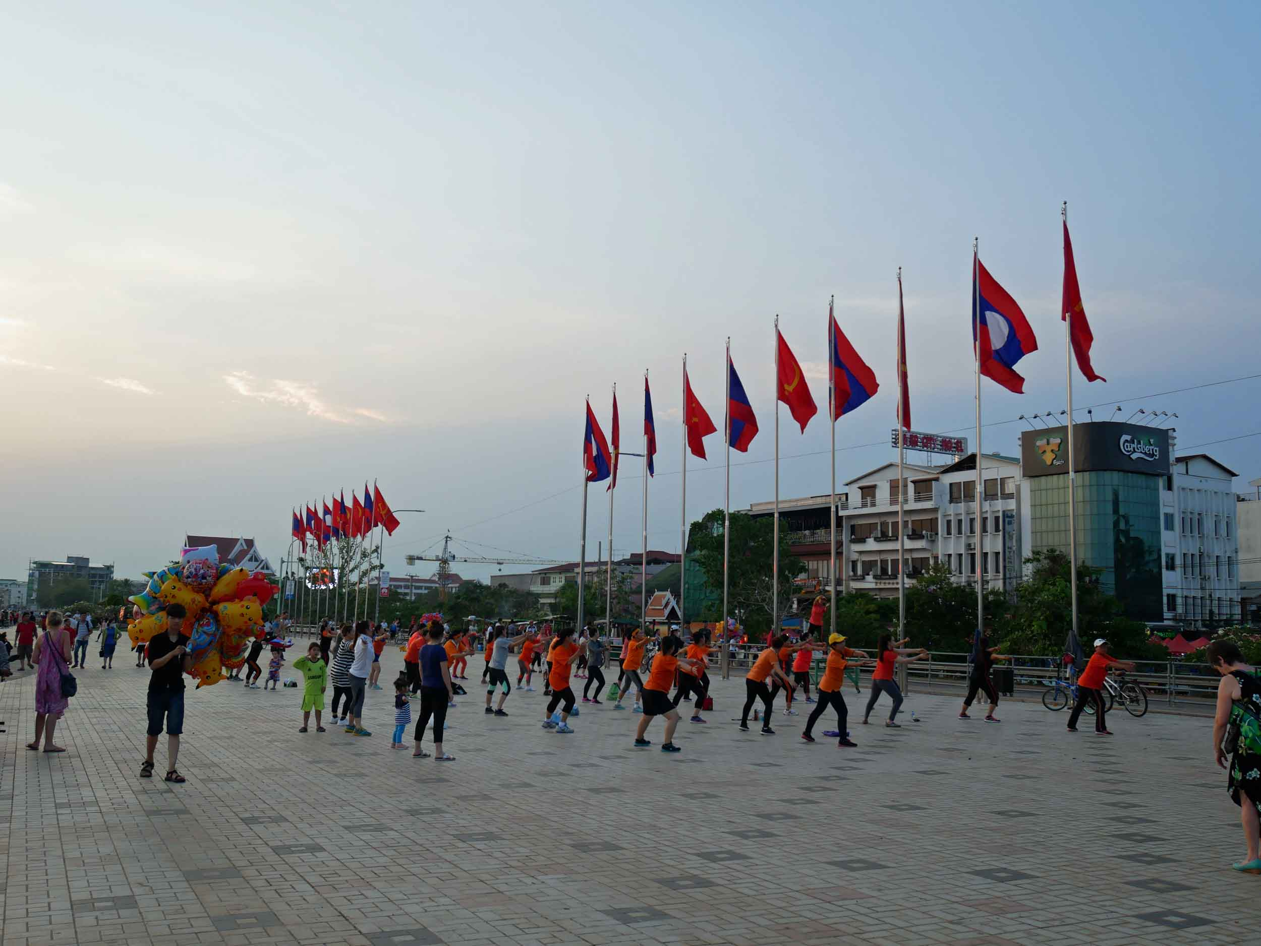 Vientiane, set on the banks of the Mekong River and across from the Thai border, has recently redeveloped its riverfront, which when we visited was full of activity, including exercise groups, food vendors, and couples strolling at sunset (March 30).
