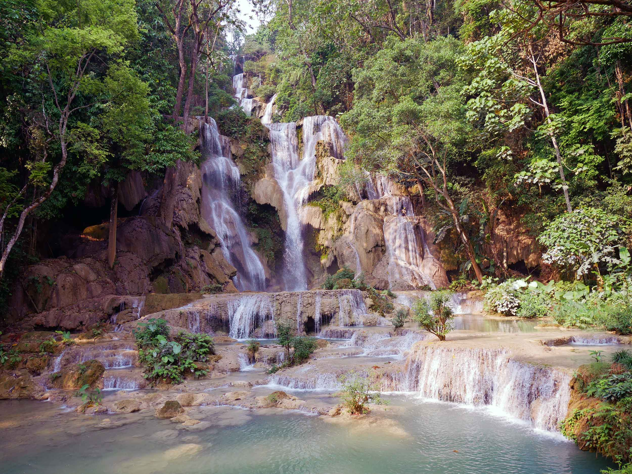 An early morning walk brought us to multi-tiered Kuang Si Falls, falling 60 metres from large pools at the top (April 5).