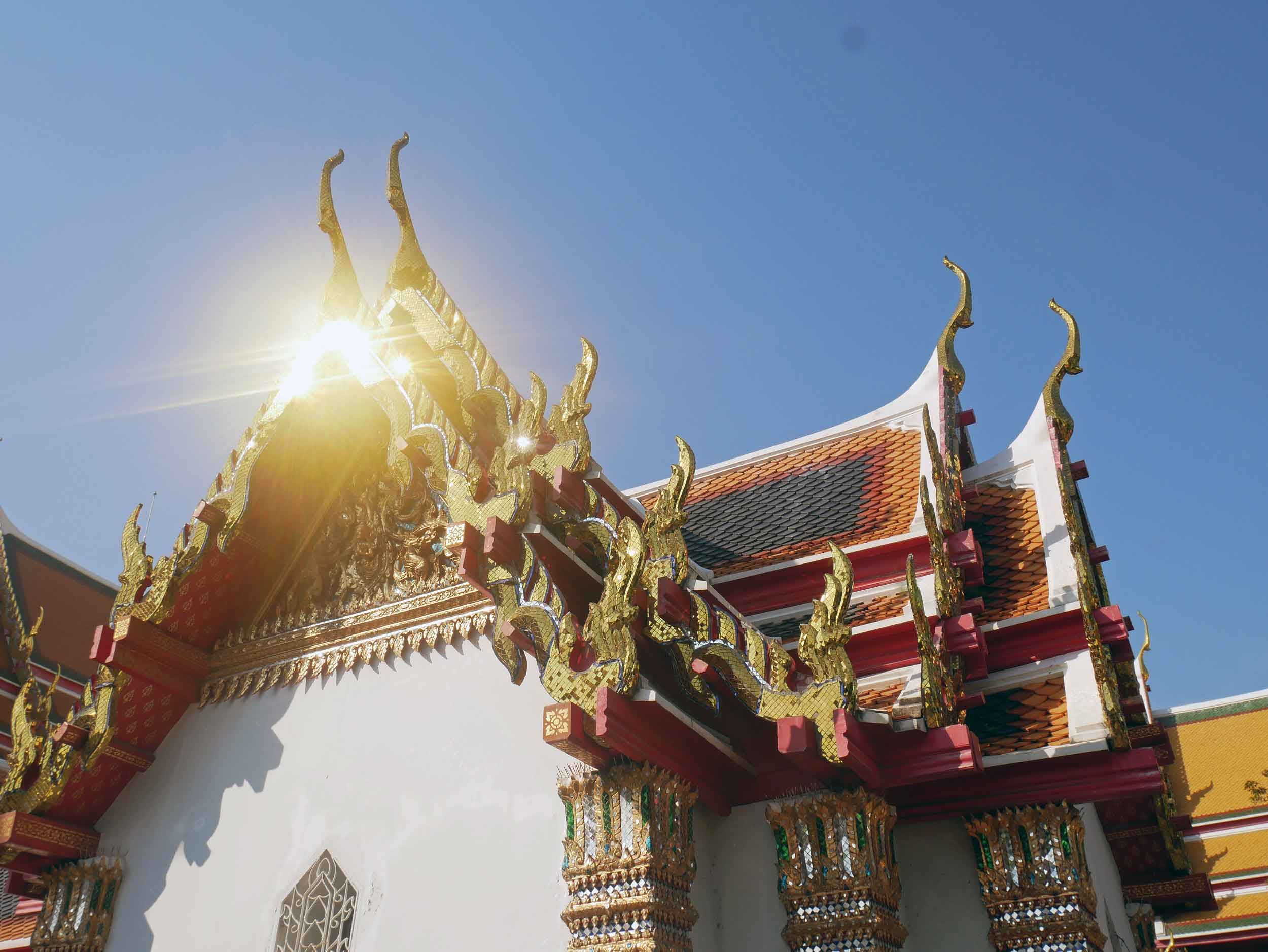 Early morning sun reflecting off one of the many buildings in the Wat Pho temple complex.