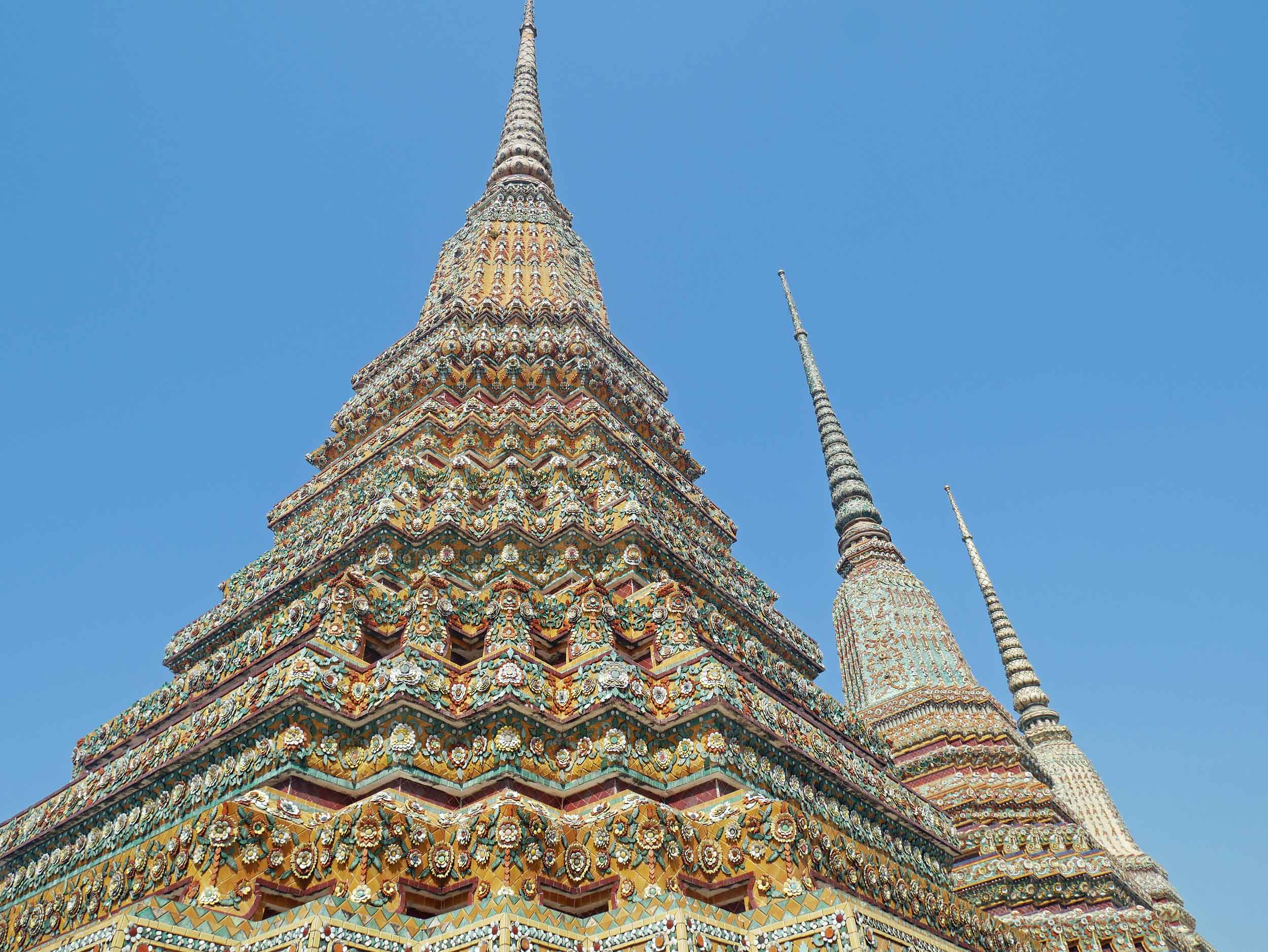 The colorful tops of Phra Maha Chedi Si Rajakarn within the Wat Pho complex and dedicated to the first four kings of Thailand's Chakri dynasty.