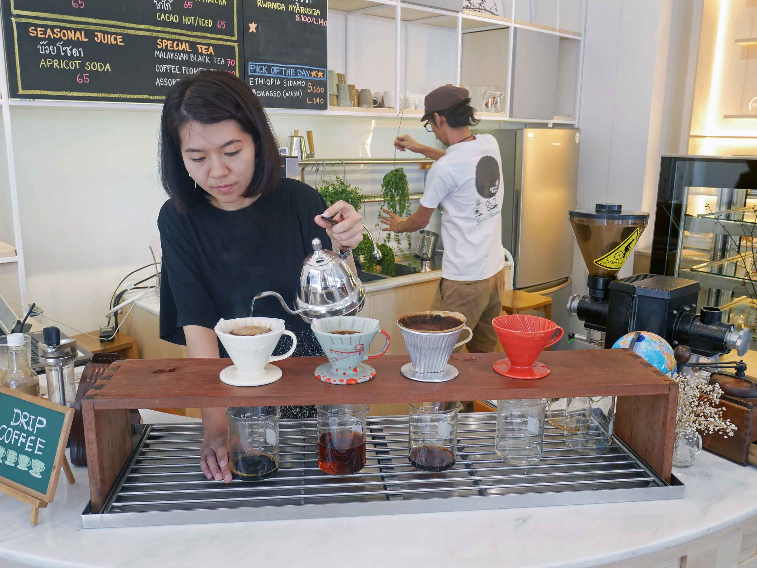 Our lovely barista carefully and beautifully preparing our cold brew coffees at Bangkok's Gallery Drip.