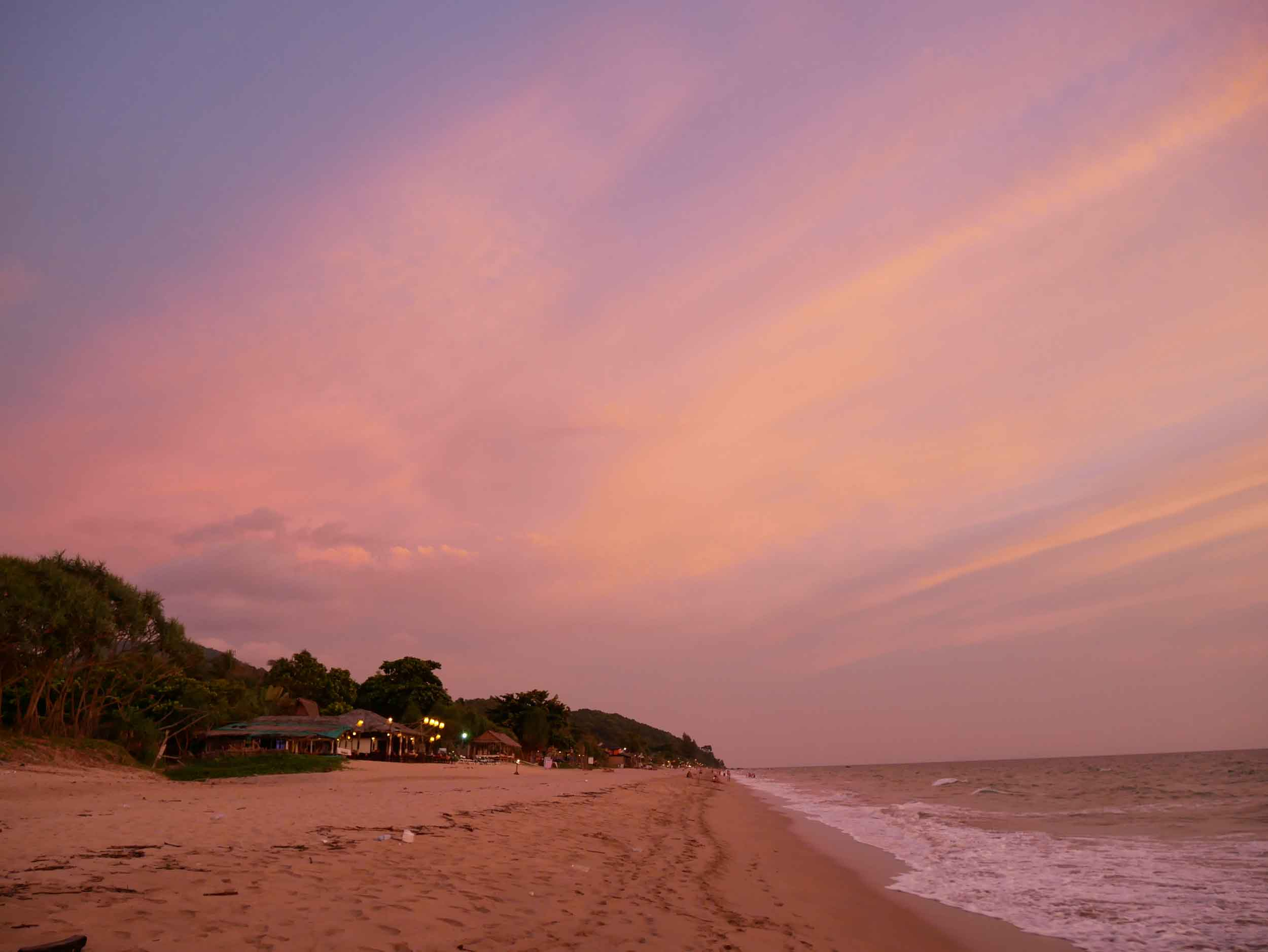 Another colorful sunset, spotlighting the many open air bars and restaurants that line the beach.