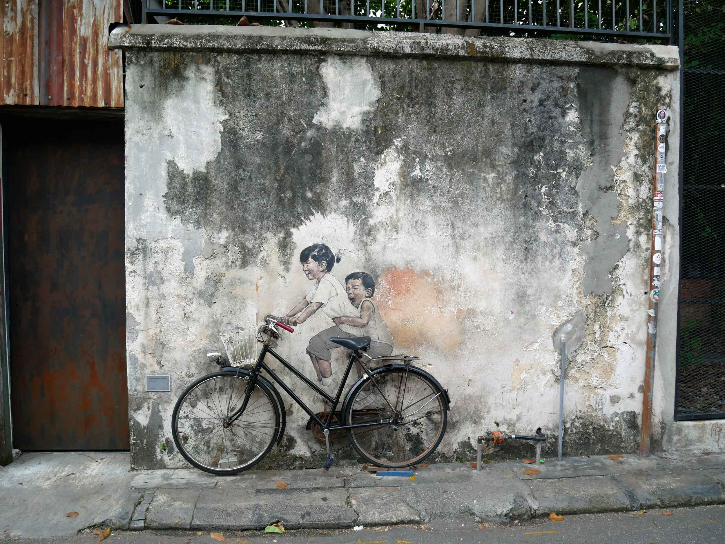 One of the more famous works by Lithuanian artist Ernest Zacharevic,  Children on Bicycle .