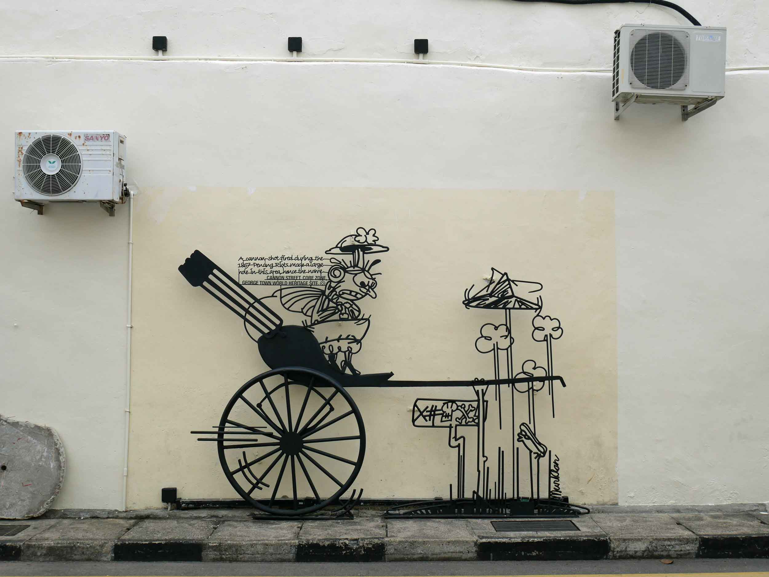The metal wire artwork, also found on the streets of George Town, is cartoon-like with humorous observations about Penang culture.