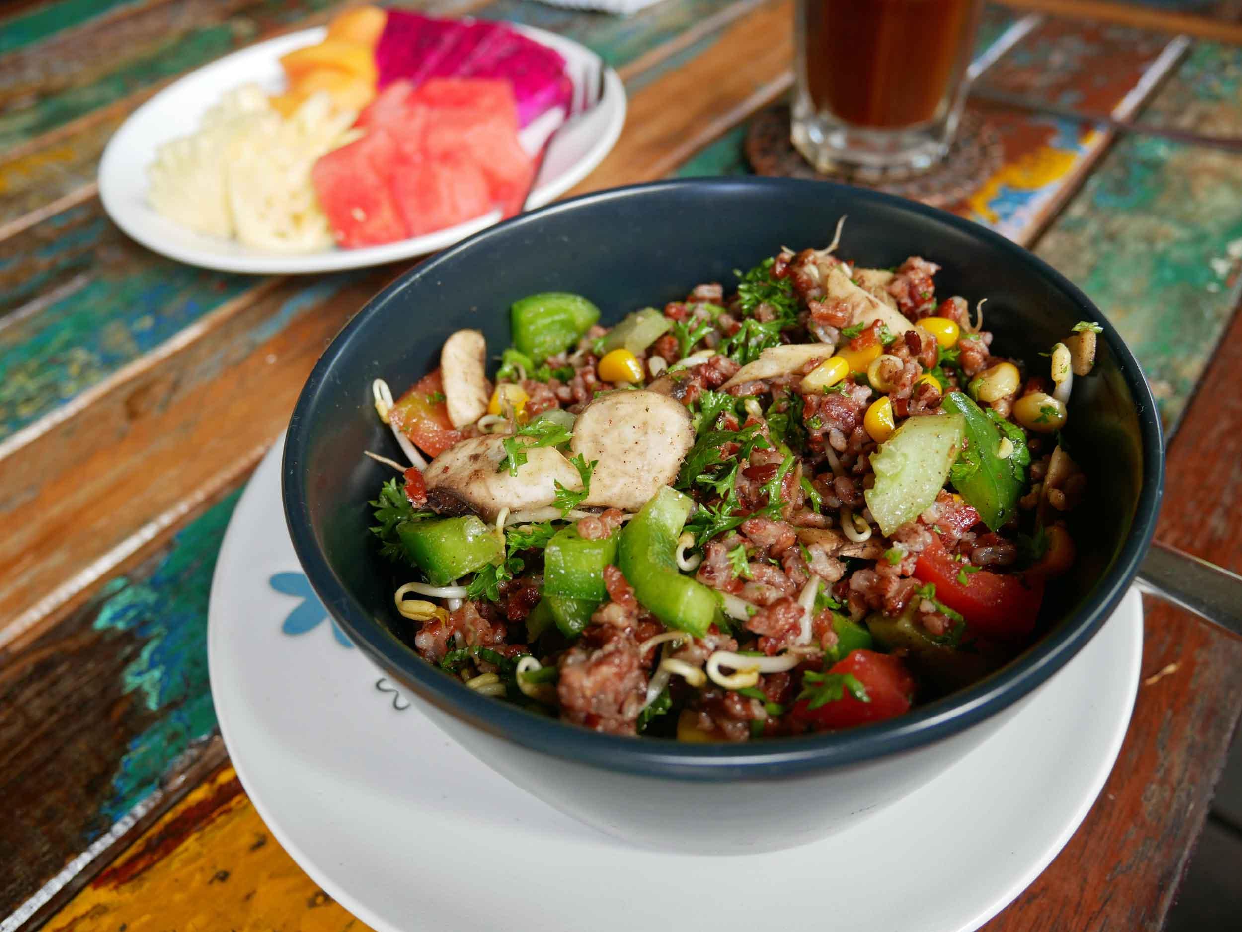 A signature veggie rice bowl and fresh tropical fruit at Bali Eco Deli (May 15).