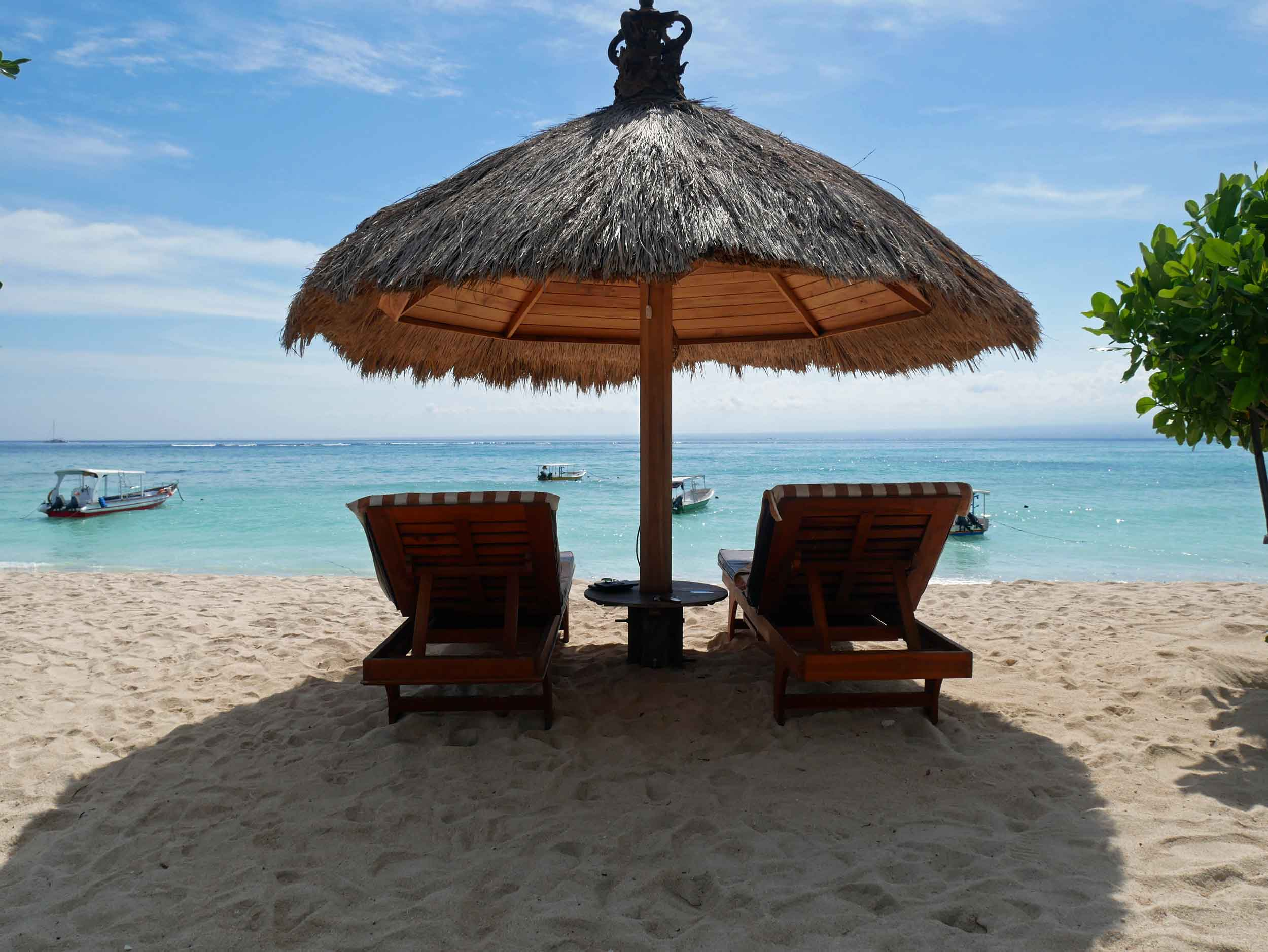 We planted ourselves under this straw umbrella on Lembongan's Pemedal Beach.